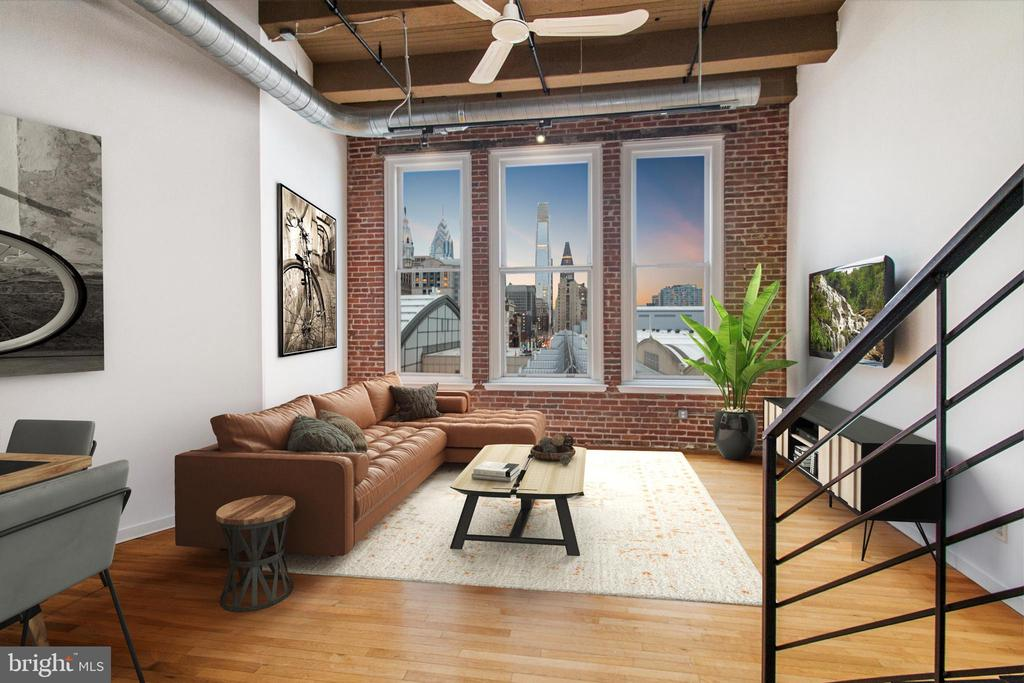 Wait until you see the views from this contemporary 6th floor bi-level loft! Historic Pitcairn Building- a dynamic area of Center City's Chinatown- with 15' ceilings and enormous windows perfectly framing a western view. Enjoy eternal views of City Hall and Philly's skyline, as well as impressive sunsets without obstruction. Main level features a large, open living/dining/kitchen area with gorgeous hardwood throughout. Contemporary onyx-style granite and stainless appliances in a custom work-island configuration with bar seating. Open living/dining/kitchen with breathtaking light. Exposed brick and an industrial-style metal staircase leads to the mezzanine level with a primary bedroom and oversized bathroom with tiled shower / Jacuzzi tub. In-unit laundry room and storage, with additional storage available for a fee. The building is well-situated at the crossroads of convenience and style in an exciting and dynamic area of Center City's Chinatown. Farm fresh produce from Reading Terminal Market, Mom's Organic, and Trader Joe's. Explore award-winning restaurants and authentic cuisine from around the world- no passport required. Intriguing entertainment options including concert venues, movie theater, major cultural attractions, nightlife, and everything Philly can offer. World-class shopping at your doorstep in the upscale Fashion District and major department stores... plus surrounding boutique shopping opportunities abound. Fantastic public transit access: Regional rail to the airport and burbs via Septa's Jefferson Station and MFL station are 1 block away at 11th & Market. Similarly, the bus terminal to NYC and other destinations is just around the corner. WalkScore of 99, TransitScore of 100! The 1027 Arch Lofts building is universally accessible with ramps and elevators. The building is pet-friendly and smoke-free. Secure mail room for package delivery. Secure bike room for your precious wheels. This is certainly a dream location for faculty, staff, and medical 