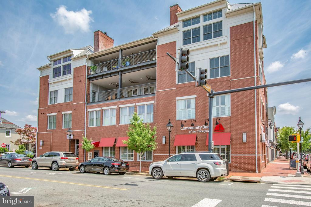 """Fronting one of the most vibrant streets in the heart of Downtown Fredericksburg, this luxurious third floor condo offers 3,364 square feet of modern and open concept living, three distinct outdoor living spaces consisting of an additional 950 square feet and a two car attached garage.  Enter from your semi-private elevator and you will be greeted with an abundance of natural light.  The gourmet kitchen features Wolfe and Sub Zero appliances and fronts a wall of patio doors opening to the first of three balconies, complete with built in grill and fireplace, the perfect place for casual entertaining.  For more formal entertaining, the dining room features a backlit trayed ceiling and, just beyond, retire to a second balcony to finish off the evening with family or friends.  End the perfect evening relaxing by the fire in the spacious primary with en suite bathroom including floating cabinetry, heated floors and stand alone soaking tub.  The versatile primary's en suite sitting room is perfect for an office or home gym and opens to it's own private balcony.  Two more bedrooms with en suite bathrooms are situated on the opposite end from the condo's primary suite.  Completing the living space is a spacious living room with marble surround fireplace and a separate study/office with contemporary barn door for privacy.  """"And only blocks from………."""", not here, welcome to the block!  Step outside to downtown's """"restaurant row"""", the farmer's market and Hurkamp Park.  You're not just close to downtown, you are a part of downtown."""