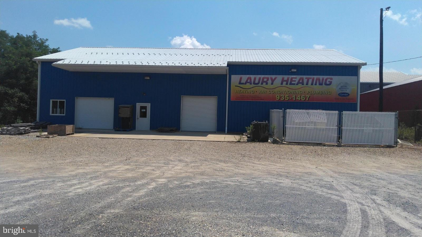 """Warehouse 50x80 with 200 amp electric service.  Built in 2008.  Shop within the warehouse 25x50 with 9x7 roll up door and man door 3' x 6'8"""" with HVAC full electric and lighting throughout.  Lower level open area 50x65 with 9' ceiling height from concrete floor with 9x7 roll up door and 3' x 6'8"""" man door.  Lighting throughout.  Upper Level 3700 sq ft open area with 7' ceiling height to bottom of free span truss bottom cord.  Sky light throughout, fully lighted.  Stair case from lower level.  Fork lift loading area for the second level within the 9x7 roll up door.  Concrete exterior apron across entire front, 20' deep.  Recycle and trash fenced in and gated area.  Parking and loading area more than ample.  Fenced in yard surrounding building.  Locations: 4.5 miles from entrance Rt 295 N; 5.1 miles from entrance to Delaware Memorial Bridge; 3.1 miles from entrance to Salem Port Authority."""