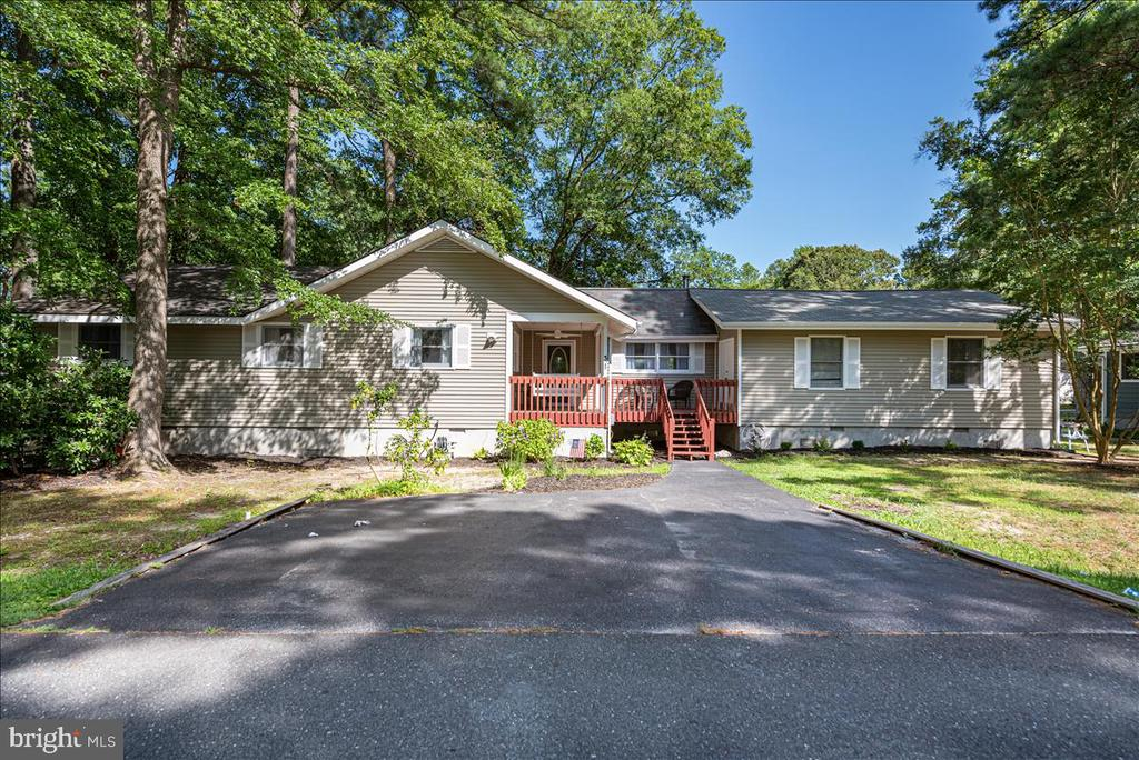 Beautifully renovated 4 bedroom, 2 bathroom waterfront home in the highly desirable Ocean Pines neighborhood. Enjoy having your boat right out the back door and only being minutes from the open bay.  This house sits comfortably on a large corner lot and is just down the street from the Swim and Racquet  Club with it's bay front pool, kiddie pool/splash pad, and tennis court. Also nearby is Whitehorse Park and the Ocean Pines Community Center that offers a playground, basketball court, and a skate park! Full renovation just completed this summer. Bulkhead along the canal is maintained by the HOA.