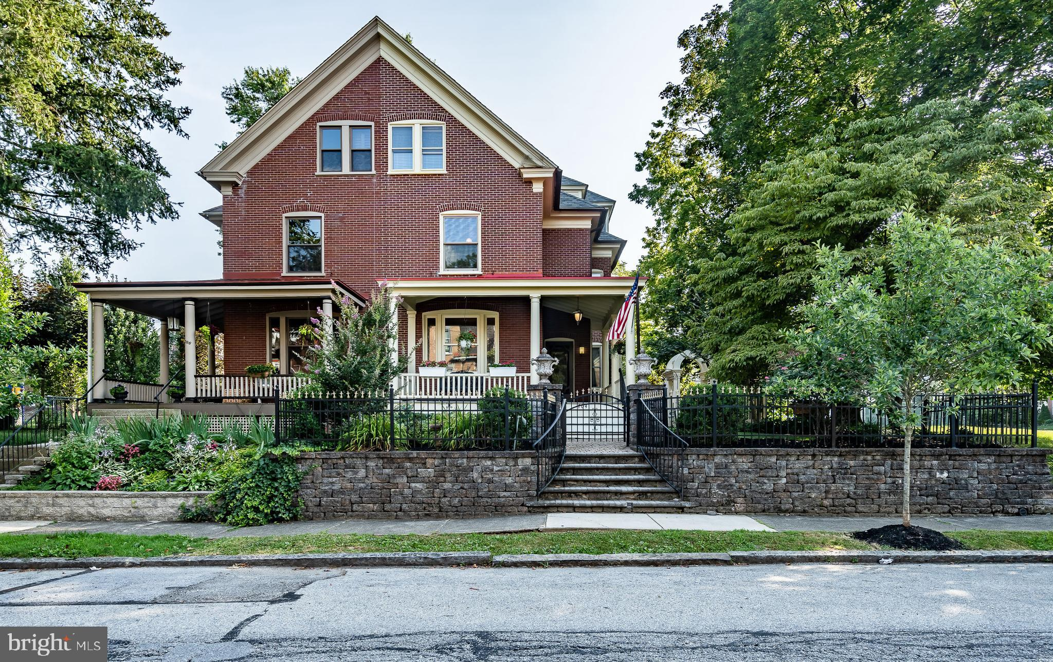 Spectacular updated both inside and out Victorian twin in the Borough. An entertainers delight paver walkways both front and side. Fantastic backyard with large entertainment area. Waterfall, koi pond, covered front and side porch, outdoor second floor deck and detached modern brick 2 car garage. You will enter and feel all the original charm as you go into the vestibule. Entry foyer leads you to the formal living room with impressive moldings and gas fireplace with ornate mantle. The next area of living space on the main floor has been open up much to give the desirable open concept. A fantastic gourmet kitchen includes large center island, high end granite, stainless steel appliances, architectural lighting, a breakfast area, family room, recessed lighting, exposed brick wall. At the rear of the First floor is convenient entrance from the outside area a full-sized laundry plus a full bath.  Second floor offers 3 bedrooms totally remodeled hall bath, the 3rd floor is unique has outside fire escape entrance additional private entrance as where current owners has used the third-floor area as a legal rental, offers kitchenette full bath, living room and bedroom.  Third floor could also serve as full use by owner making it a 5 bedroom 3 bath single family with no alterations. The character on all 3 floors offers its original character to include, high end wood flooring, tall ceilings, and exposed brick walls. Radiator, natural gas heat, 2 separate air conditioning zones makes all 3 floors centrally aired. The second floor also offers an outside entertainment deck, this is a one-of-a-kind property that the current owners restored through painstakingly sparing no expense. Please view the video tour.