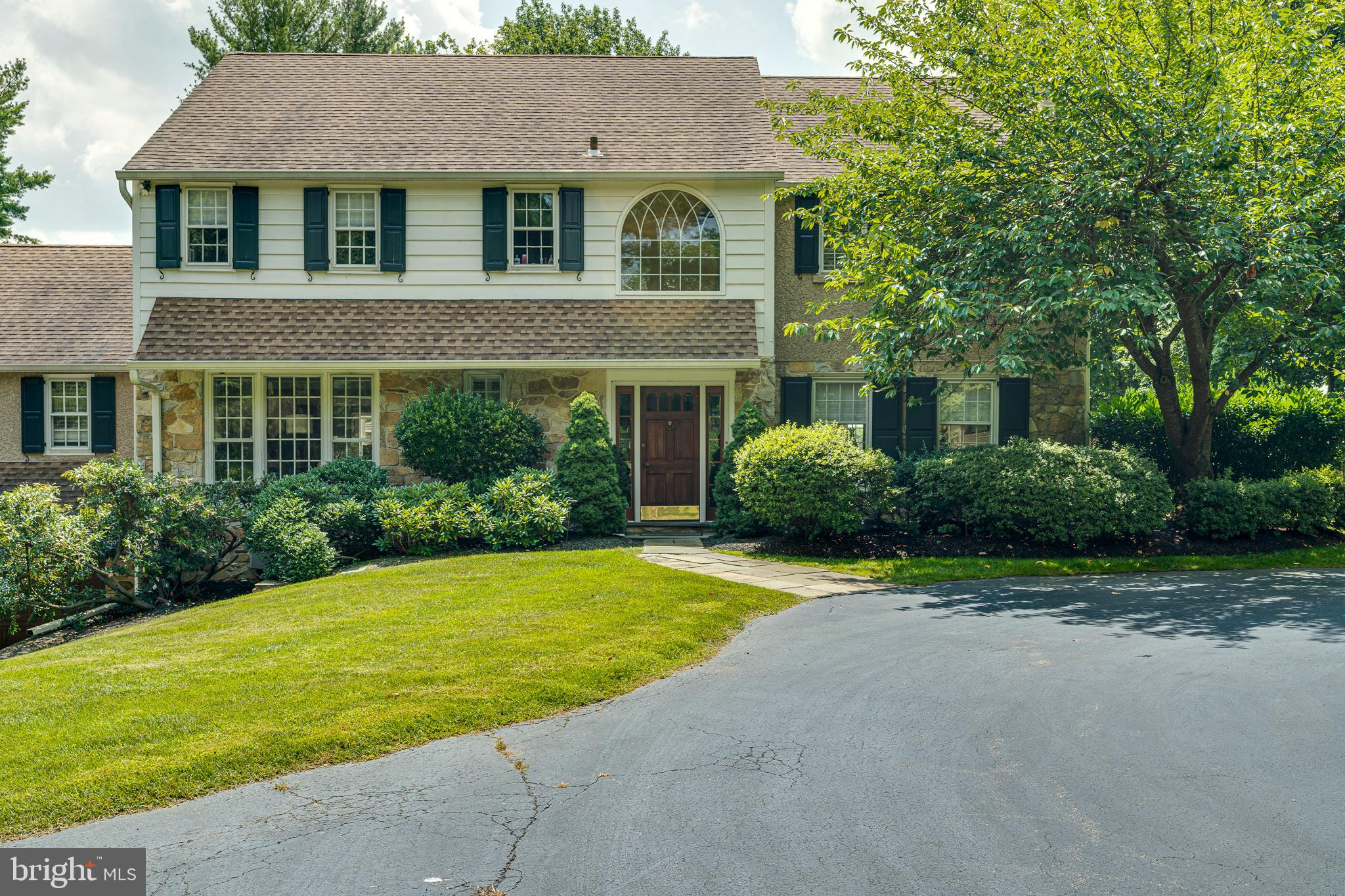 Rare opportunity to own a beautiful home that overlooks the 17th hole of the prestigious Merion East Golf Club.  Enjoy this 3 bedroom house on a private 1.69 acre lot with inground salt water pool, spa and gazebo and  a large 2-car attached garage.   The  circular driveway brings you to the front door surrounded by lush terraced landscaping and magnificent trees.  The 2 story center hallway leads you into the living room with fireplace, a staircase to the 2nd floor, a 1/2 bath, stairway to basement and eat in kitchen.  There is a fully equipped first floor laundry room and family room/office with fireplace full bath and wet bar.  The light filled dining room can be entered from the kitchen and living room and overlooks the beautiful deck and grounds.  The upstairs has a large master suite with master bath and walk in closets and walk up attic.  There are 2 additional bedrooms and   full bathroom completing the upstairs space.  The basement has a full walk out which leads to the garage.  The property was renovated  in 2014. Included in the renovations were:  new roof, attic insultation, exterior stucco and cedar siding, paint-inside and out, refinished hard wood floors, new kitchen appliances, washer & dryer, new high efficiency heater installed in the unfinished full basement, air conditioning with 3 zone secondary programmable thermostat,  secondary air for upstairs, estate fencing, new back patio doors and automated irrigation system.  pool & spa entirely renovated with all new equipment, new plaster & tile.  New back patio doors in 2018. Recent renovations (2019) include deck refinishing .  This property is within walking distance to Haverford College, shopping, transportation,  hospitals and restaurants.  Don't miss this rare opportunity for convenience and luxury.