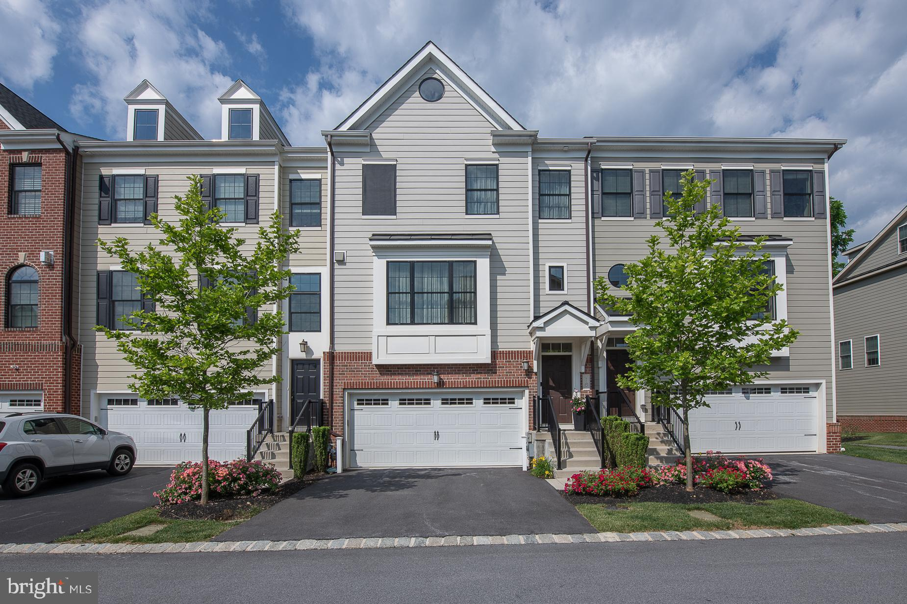 Amazing townhome at Parkview in Chesterbrook.  This 4 bedroom townhome has many upgrades, including the 4th bedroom and full bathroom located on the entry level which also has an oversized patio off the additional family room/office.  This space can easily be used as an in-law suite or private space for visitors. The main level includes many upgrades including Thermador appliances, granite countertops, light fixtures and deck with gas hookup for your grill.  The master bathroom has a beautiful freestanding soaking tub and large walk in shower, offering a spa-like atmosphere.   It gets better, the top floor includes another deck that offers privacy and a retractable awning that makes the space relaxing and enjoyable.  The townhouse has hardwood floors on every level and upgraded spindles on the staircase.  This meticulous home offers privacy in the rear and designated open space view from front!