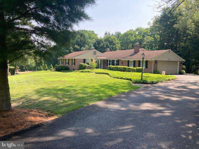 Immaculately maintained and updated 3 BR, 2.5 Bath brick ranch on a beautiful 1 + acre lot with pool in Hockessin hills!  Pride of ownership shines through as you tour this home.  The kitchen has been re-modeled with granite counters and island, hardwood floor and pass through to the family room.  The HVAC has been replaced with a heat pump with oil back up and the roof was done in 2006 with 50 year shingles.  You will also enjoy beautifully remodeled bathrooms and powder room.  Take your pick of relaxing by 2 fireplaces and in the summer months enjoy the large screened porch overlooking the fabulous pool and private rear yard.  This property just screams relax! Come take a look!