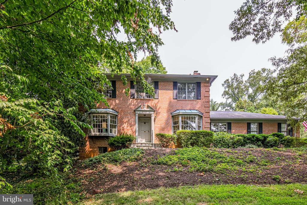 ***OFFERS DUE TUESDAY, JULY 27 @ 12PM***Gorgeous all brick colonial nestled on .80+ acres in a SUPERB LOCATION! Huge living room with wood fireplace with access to the outdoor quiet brick patio. Formal dining room. Eat-in kitchen off the light filled family room. Library/den with full bath and fireplace. The upstairs features 3 bedrooms, full bath plus a primary suite with walk-in closet, dressing area & bath! The lower level is unfinished, ready for you to design it your way. Quiet country setting between the GW Parkway and Potomac River with access to the Mount Vernon Trail, lots of walking, running, cycling parks,  minutes of Old Town Alexandria, Ronald Reagan National Airport and downtown Washington, DC.