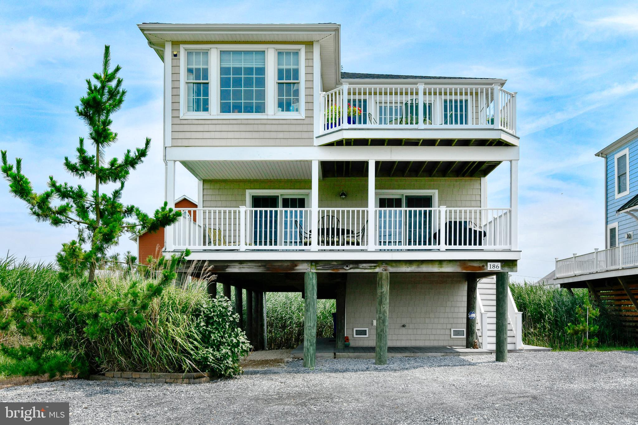 Ready for private, bayside living in a beautiful custom home from Dream Builders? Look no further than this raised 2-story, 4-bedroom gem with over 2,000 square feet of living space! Built in 2009, this location is tough to beat, offering a private setting right where the St. Johns River enters the Delaware Bay. You'll enjoy water views from two sides and a panoramic overlook of state land from two outdoor decks and the 3-season porch! On the first floor, you'll walk into a private living room with access to the 27-foot wide deck. Down the hall are 3 spacious bedrooms, a full bath, and generous laundry room. The staircase leads up into the open-concept kitchen and great room with gas fireplace for fall and winter months. In front is the second deck and beautiful 3-season room, perfect for relaxing with guests and enjoying stunning sunsets over dinner and drinks. Towards the back of the home is the large primary bedroom with private full bath. The federally rated pylons provide a discount on flood insurance – the policy being only $756 annually. Additionally, the home features 6 inch wall construction, Pex plumbing, Anderson low E glass windows and sliders, public sewer and a private well with purification system. The first floor has economic heat pumps with electric back-up, and an electric HVAC system on the second floor. As an added bonus, you're only one street away from access to the water and within walking distance of the small town of Bowers Beach. Stroll to The Bayview Tavern or JP's Wharf, then cap off the evening with Barnacles Ice Cream. For more restaurant and shopping options, both Dover and Milford are a quick drive. This home epitomizes the slower, lower Delaware lifestyle that so many people are seeking! Schedule a showing today!
