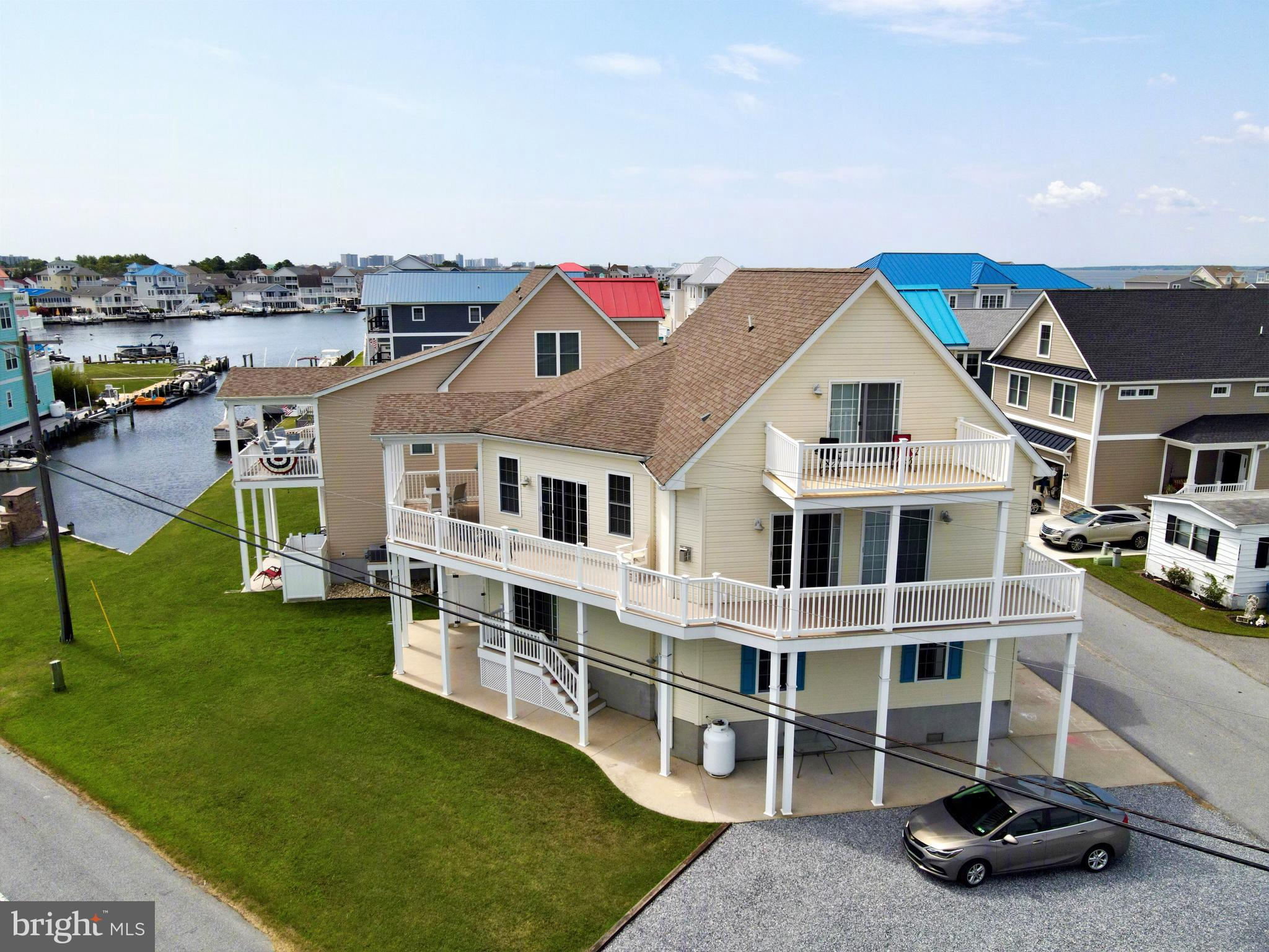 Gorgeous coastal home with impressive bay views located just 1 mile to the pristine wide Fenwick Island beach. This spacious 5 bedroom, 3.5 bath home was designed with the idea that multiple generations would gather, with a great room and kitchen on the main living level and an additional kitchen and living area on the first floor, allowing room for everyone to spread out. Featuring fine finishes such as beautiful hardwood flooring throughout the main living areas, gas fireplace, granite countertops, and stainless steel appliances, this home is ready to be enjoyed or a great investment property with a proven rental history. Enjoy the bay breeze and the water views from multiple decks and porches. Located in the community of Cape Windsor offering a swimming pool, boat ramp, boat storage area, and playground. Boaters can enjoy easy access to the Big Assawoman Bay and everything that Ocean City offers!