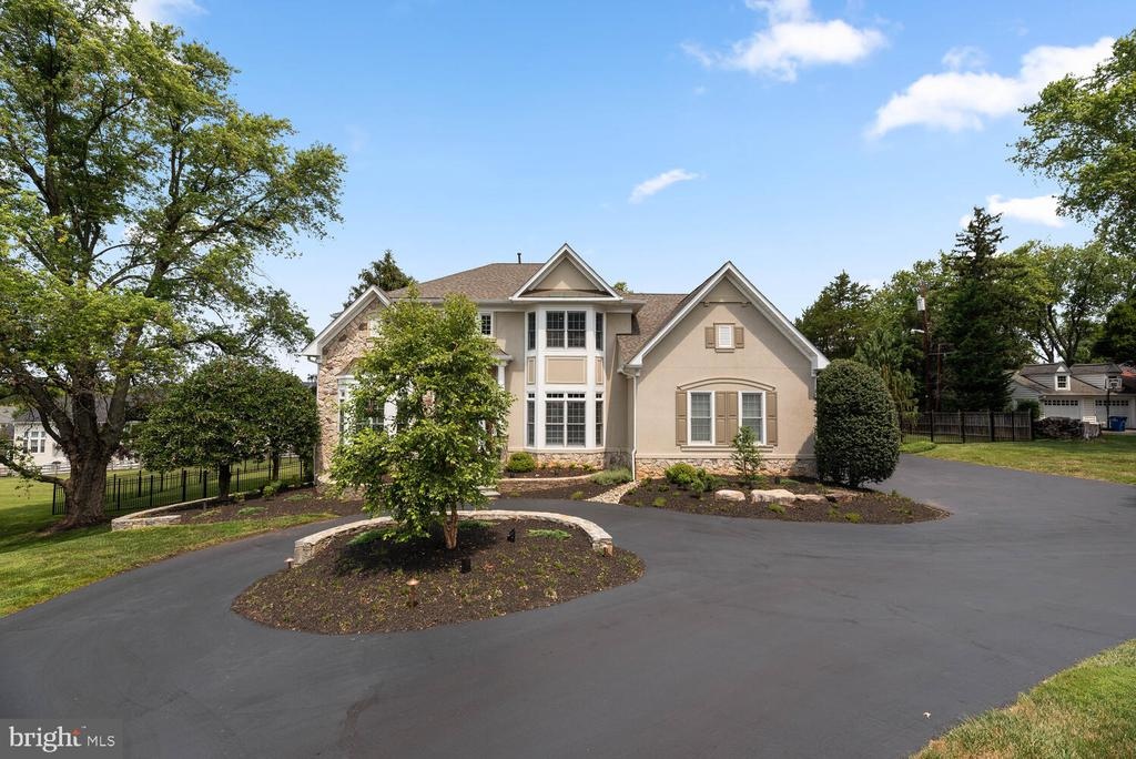 Welcome to this STUNNING John Laing custom built home, in the sought after community of Potomac Glen Estates. From the elegant grand foyer, to the gorgeous backyard, and FOUR car garage, you will love all this home has to offer.  Not one detail has been spared, and pride of home ownership is abundant. Boasting 6 bedrooms, 5 1/2 baths and over 7,300 square feet, there is no shortage on space for family or entertaining.  As you enter the two-story foyer with gorgeous columns separating the space, you will be delighted with the expansive, yet functional first floor layout. Amazing home office space with built-in cabinets, glass pocket doors, lighted vaulted barrel ceiling; Living Room with gas fireplace with a beautiful custom mantle; Large dining room with tray ceiling and indirect lighting; Kitchen is completed with Maple cabinetry, Sub-Zero Refrigerator, granite countertops, ceramic floor with marble insets, large island with downdraft cooktop & sink, and two desks with undercabinet lighting; There is an additional sitting area with see-thru glass fireplace, and a large breakfast room overlooking the backyard; Large LOW MAINTENANCE DECK off the kitchen; Family Room incudes custom paneling & built-ins, coffered ceiling, surround sound, see-thru fireplace, and woven wood shades complete the room; Butler's Pantry with large countertop and cabinets; FIRST FLOOR BEDROOM W/ EN SUITE BATH and private French door leading to the deck; Mud Room has another refrigerator & freezer, as well as a large utility sink, countertop & storage cabinets; Lovely plantation shutters, recessed lighting & beautiful hardwood floors completes all of the main level.  As you move upstairs, you have the HUGE primary bedroom (approx 14'X16') & sitting room (approx 9'X12'), including TWO walk-in closets, tray ceiling with indirect lighting, patio door to private master bedroom deck & plantation shutters; Primary bath has Maple cabinets, ceramic tile with glass inserts, large shower with bench, Kohl
