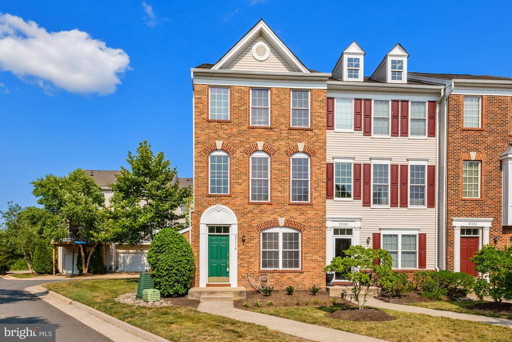 Welcome home to this beautiful 3BR, 3.5BA end unit, brick front condo/townhouse with attached two car garage in the sought after community of Amberlea at South Riding. Freshly painted from top to bottom with new carpet on upper and lower levels. The first floor offers a foyer, a light filled bedroom with an en-suite bathroom and access to the garage. Head upstairs to find Brazilian Cherry Hardwoods through out the spacious living and dining space and kitchen.  The kitchen boasts brand new Calcutta Ultra Quartz countertops, new sink and faucet and plenty of cabinet space. Glass sliding doors open on to a large deck big enough for lounging and al fresco dining! This level also has a powder room and laundry. Upstairs is a the Owner's Suite with vaulted ceilings, sunny windows and an en-suite bathroom with a double vanity, soaking tub and separate shower. The upper level also has a secondary bedroom with vaulted ceilings, an en-suite bathroom and walk in closet. The Amberlea Community's amenities include a community room, fitness center, pools, tot lots, tennis, volleyball courts, basketball courts, walking & biking trails and a lake. This location can't be beat! You can walk to parks, schools & shopping as well as easy access to Route 50 & Dulles Airport. OPEN SUNDAY 1-3 *OFFERS DUE MONDAY 7/26 at 3PM