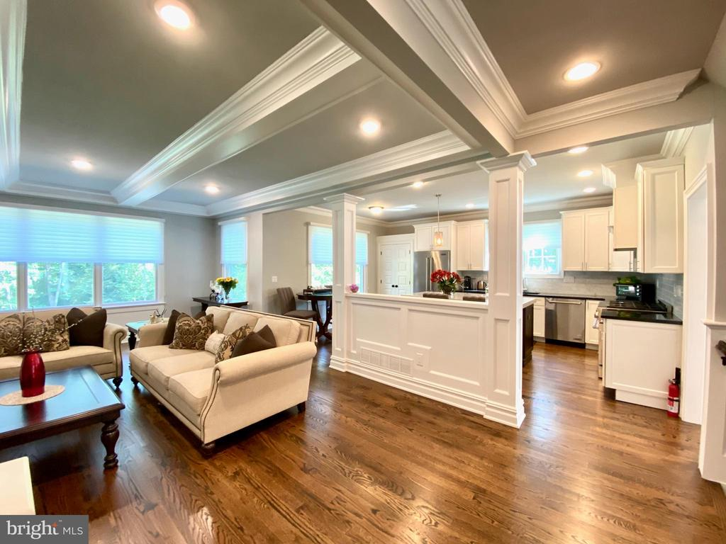 This 2017 built colonial with 5 bedroom, 5 full bathroom, attending LittleBrook Elementary School, has been impeccably maintained and lovingly cared by its first owner, featuring sophisticated moulding, wainscoting, coffered ceiling, main-level master suite, finished walkout basement, and 0.5 acres tree-lined back yard.  Hardwood floor throughout main and upper level. 2nd floor laundry. Elegant white kitchen with central island offers stainless steel appliances, sleek cabinetry, pantry, granite counters, 6 burner range and exquisite lighting fixtures. Sunlit family room presents custom built-in bookcases surrounding the cozy gas fireplace with modern mantle. Lavish master suite on the main level overlooks lush open serene back yard. Spa-like master bathroom with high-end fixtures and gleaming tile-work. An office adjunct to the modern full bath is perfect for working from home, or could be the 6th bedroom. The upper floor features 3 bedrooms and 2 full baths and laundry room. The finished lower level, equipped with full bath, a bedroom, large recreational/gym space and a media room, walks out to the back yard. Close to downtown Princeton, Charter School, shopping and Rt 206.  Rare newer home in Princeton, don't miss it!