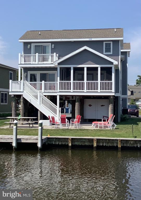 Welcome to South Bethany!  This custom built Miken home is looking for new owners!  Only 7 years young, this canalfront home has everything you could ask for and more!  Lots of upgrades inside and out from the paver patio out back to the granite countertops in the kitchen!  Enjoy the sunsets off your rear deck or screened in porch!  Can't have a beach home without an outdoor shower - this home has 2 of them!  Are you a boater?  Or would like to be one?  At this home you can park your boat at your backdoor!  Lots of space for extra cars as there are 2 spots in the carport and the driveway can fit another 2 easily!  Maybe more!   Stainless steel appliances, custom tile shower, wainscoting, LVP flooring and Trek decking.....the list goes on and on!  Come tour this home while its available!