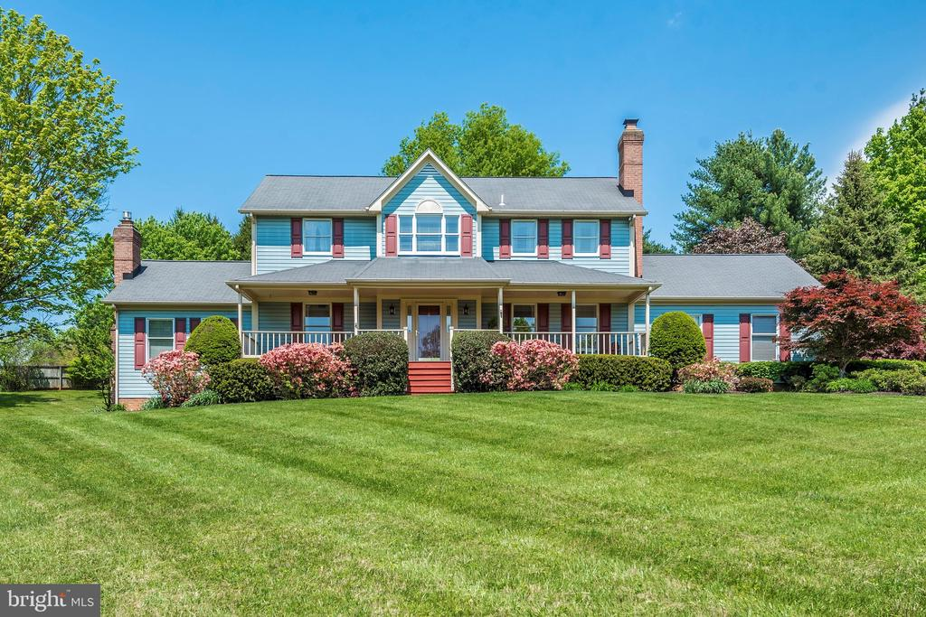 Beautiful, absolutely spotless and impeccable home in sought-after Glenelg school district. 3.34 acres in a gorgeous park-like setting, with beautiful views out of every window and from the spacious front porch. There is also a charming screened in porch off the kitchen, and an open deck in the rear, and a beautiful hardscape patio. Inside, there is  a two-story turned staircase with an open gallery walkway to the Master Bedroom, which features a cathedral ceiling, walk-in closets, and fabulous Master Bath with tile, granite, and built-ins. Beautiful main level with gleaming hardwoods, L-shaped kitchen with a really large Breakfast Room overlooking the unique sunken Family Room. FR is huge, and has a stunning masonry fireplace, wet bar with wine fridge, high ceilings, and sliders to the rear. There are windows everywhere in this house for lots of light and views of the grounds and greenery wherever you are. Nice laundry room on first floor with washer and dryer. There are two big pantries, a powder room, formal dining room, living room, and cozy private den. TWO fireplaces, one wood-burning, and one gas. Three-zone heating and cooling. Basement is finished with rec room, two other finished rooms, possible 5th/6th BRs and a full bath. Great storage area, too, with utility sink. Sellers have lived in this quality home since it was built, and lovingly and meticulously taken care of and maintained it. Privacy, beauty, and yet convenience to everything and all major routes. They have an AHS Home Warranty which will convey to buyers for 1 year. OPEN HOUSE SUNDAY JULY 25th, 1 - 4 PM.