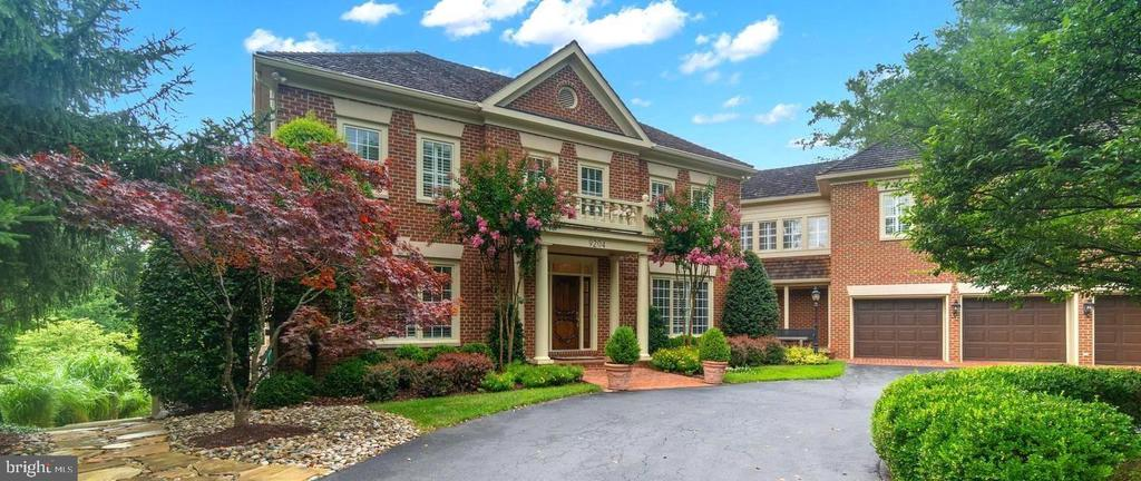 Welcome Home to this gracious, expanded grand colonial  7 bedroom 7 bath/1 half bath 7400+ sf home in the desirable Avenel Community of Potomac. Journey up the long driveway leading home that is tucked back in the private cul de sac. Once through the front covered portico, the foyer leads to a formal living room, dining room and family room. The library is perfect for today's balancing of multiple zoom meetings (optional main level 8th bedroom with sitting room) and offers walls of windows overlooking the backyard oasis. The family room with gas fireplace, custom wood cabinetry and french doors that open to the upper balcony deck for al fresco dining. The stunning gourmet chef's kitchen has a floating expansive center island, multiple granite countertops for meal preparations and presentations, professional grade SS appliances, and custom wood and glass door cabinets. Thoughtful conveniences such as a powder room, oversized mudroom/laundry room leading to the three car garage, and a third entrance to enjoy coffee, read a book, or wait for guests on the front patio. The gourmet kitchen opens to the spectacular white, bright sunroom with wood beamed ceiling and endless windows. Perfect for a table space eat-in kitchen/dining area or enjoying the upper level of the tiered deck that steps down to the breathtaking grounds of the estate. There is an expansive stone terrace, gorgeous copper, heated swimming pool with automatic safety cover and a free standing custom spa to unwind and relax. Mature trees and flowers  frame the grounds for total privacy. The upper level hotel-like floor plan is ideal for how we live today with an ideal flow for large families. The owners' suite with elegant dressing room and third level balcony plus five additional bedrooms (three ensuite) each with their individualized custom architectural accents offer expansive living quarters. There is an oversized family room/lounge for spacious and comfortable living.    This estate has been designed a