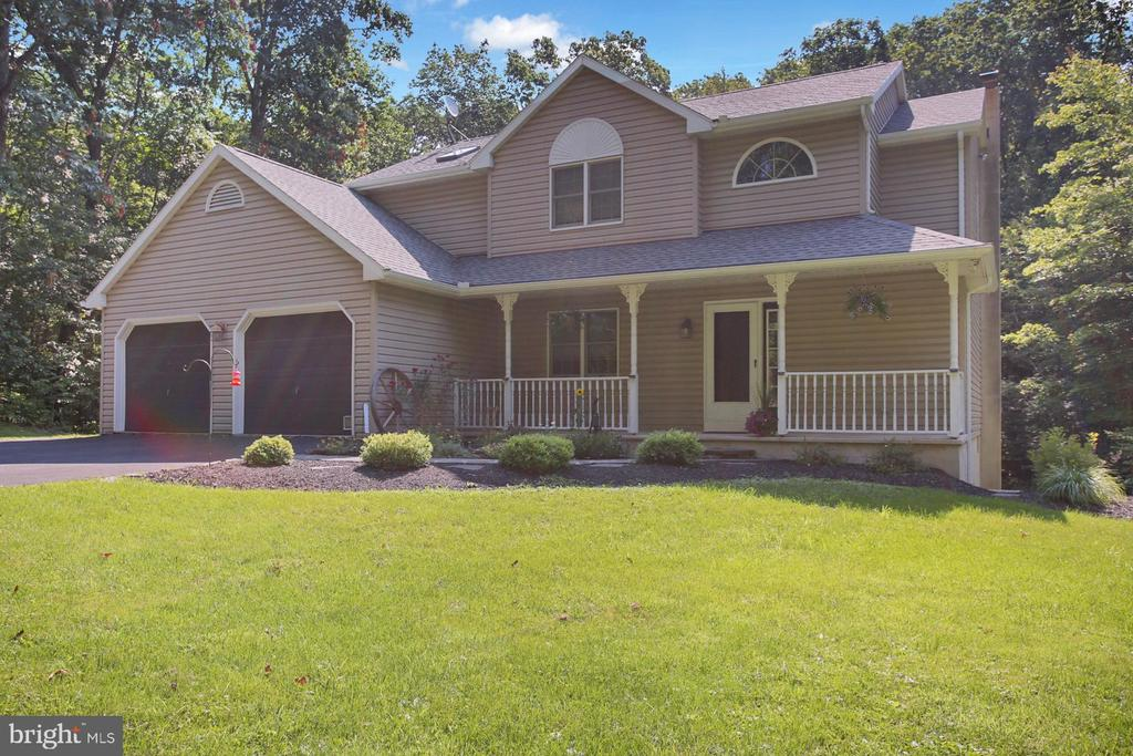 Welcome to 212 Mountain Mary Road in Oley Valley School District. Nestled on a stunning, 2-acre lot, this home is sure to impress. A relaxing front porch awaits as you approach the home. Come through the front door and you will immediately notice the beautiful hardwood flooring  that continues down the hall and into the spacious dining room. A powder room is on your right and a sitting room/study will be to your left. Continuing into the home, you will love the updated kitchen with gorgeous custom cabinetry, granite countertops, tile backsplash and stainless-steel appliances. Grab a cup of coffee and take a seat at your convenient, built-in breakfast area with even more beautiful cabinetry. There is also a pantry and mudroom with washer and dryer hookup. Off the kitchen, step though the French doors into the great room boasting tons of natural light, vaulted ceilings, a propane fireplace and window seating with storage. From here, walk through another set of doors and enjoy the serenity of your ample, newly constructed, Timbertech deck. Moving upstairs, you will find the master bedroom with oversized walk-in closet and stunning master bath with two sinks, granite vanity and even more custom cabinetry. Two more generously sized bedrooms and another full bath complete this level. Finishing out the home, you will find a lower level with the most amazing laundry room you've ever seen, the 4th bedroom with sliders to the rear yard, and a section of unfinished basement space containing the mechanicals, pellet stove for cold winter nights, and plenty of storage. The fabulous outdoor space includes the aforementioned deck, lower level patio, shed, and a spacious backyard surrounded by trees and serenity. Economical heat pump/central air system installed in 2020, new deck and railings in 2020, new roof and gutter guards in 2019.  This gem won't last long! Schedule your tour today.