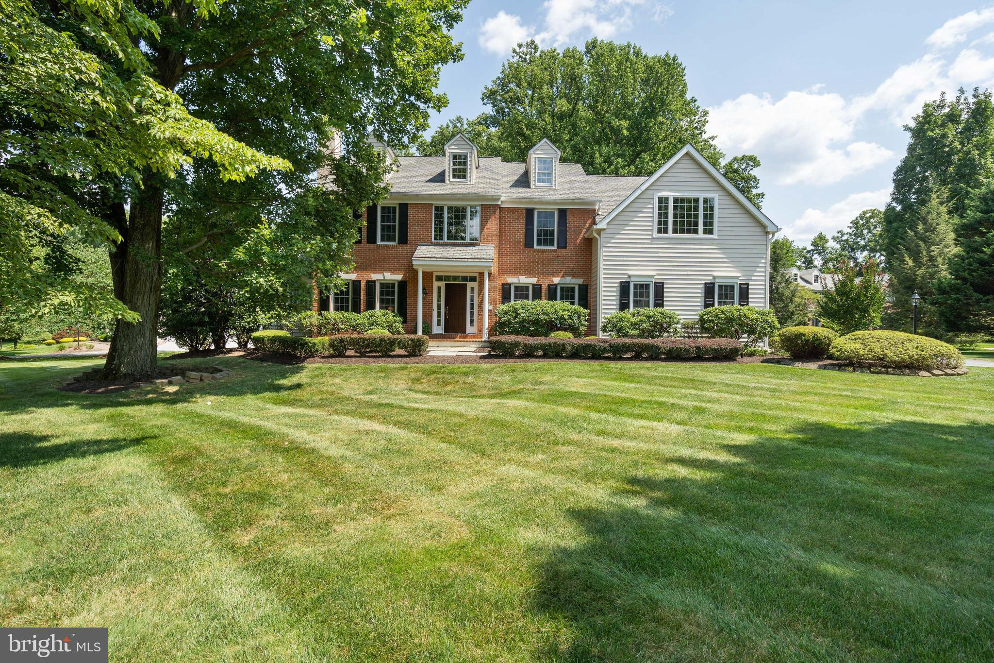 As you enter through the front door into the open and bright two-story foyer there is wainscoting and chair rail with gleaming oak hardwood flooring on most of the 1st floor. To your left is the formal living room with crown molding, wood burning fire place with marble surround and hearth as well as ceiling accent light above the mantle. Lovely custom window treatments are included. Off of this room you step down into the spacious bright sun room complimented by the lighted ceiling fan. The formal dining room to the right of the foyer is complimented with wainscoting, crown molding, electric wall sconces and beautiful custom window treatments. Continuing you come to the kitchen drenched by sunlight. With open view and same wonderful brightness you also see family room a little to left. Large kitchen stainless steel, high-end appliances (Wolfe wall oven, Thermador cooktop, Bosch refrigerator). Heptagon shaped Island, deep pantry closet. Back staircase located here. Anderson sliding door leads you to new composite deck with vinyl railing for low maintenance. Just off the kitchen is laundry room with large coat closet and front loading washer and dryer (Electrolux) with laundry pedestal with storage drawers. Entrance to 2 car garage with automatic openers. (Recently freshly painted). Door to outside as well. Parking for 6 cars on property plus street. Kitchen opens through to family room brining this same bright and spacious feeling. Floor to ceiling stone wood burning fireplace with raised hearth. Additional entrance to deck via Anderson door is also found in this room. Complimented by a ceiling fan. Enter through the French doors into the library/office which features built in bookshelves w/lower cabinets along with window seat and ceiling fan where you'll discover a cozy retreat. As you come to the 2nd floor you will come to appreciate 2 zone heating/AC. Which includes wall-to-wall carpeting and you'll find a stunning view of the family room and foyer from balcony. 
