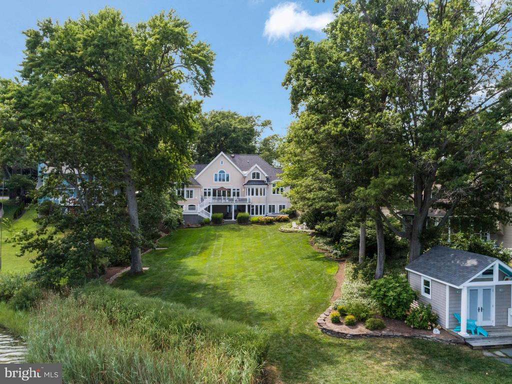 """Fabulous Custom Bay Ridge Waterfront in Annapolis, with Private Deep Water Pier situated on .634 acres. 7,251  Finished Square Feet of Living Space along with 1,446+ Square feet of Exceptional Outdoor Entertaining/Lake Living Lifestyle Space! MUST SEE PHOTO'S & VIDEO! In the first """"20"""" Seconds of entering your NEW home you'll be captivated by the View and enchanted by the wonderful Open floor Plan.  Gravitate towards the spacious wonderfully designed Kitchen,  Or simply envision yourself in the Family Great room with Stone Gas Fireplace but don't forget about the Main Floor Master Suite along with separate Office before stepping outside on your Deck, perfect for Entertaining).  Before going back inside  I suggest a quick walk to your Pier with 3 different size boat lifts and Envision the fun you'll have!  You may now need time to relax on your Lower Level Outdoor Covered Stone Patio that includes a Hot-Tub. or simply go straight inside to your lower Level Theatre room plus Recreation Room that includes a Bedroom and full 2nd Kitchen and Exercise Room! If sleep or down time is what you need now, the Upper Level includes """"3"""" Bedrooms as well as a Hobby/Study area and a quaint Reading nook! The Bay Ridge Lifestyle is unmatched in all of Maryland!  Swim across to Community Marina, Playground, Basketball/Pickel Ball court, Kayak racks etc..., Walk to Community Pool,Beaches,Baseball/Soccer,Lacrosse Field!! Whether your a SUP enthusiast, Dog Walker, Hiker,(Trails in the BIG WOODS!), Runner, this Neighborhood has it all! ,Call LA (who Lives in the Neighborhood and is the TRUE Bay Ridge Specialist for further details,"""