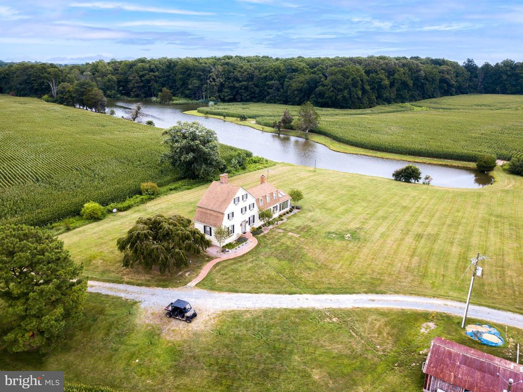This Eastern Shore Estate is being offered with two separate side by side parcels (Tax ID 2103131173 & 2103115860) totaling 325.5 acres. With approximately 150 acres of tillable land and approximately 175 acres of hardwoods with two large stocked bass ponds and over 3,000 feet of tidal river frontage along Miles Creek, a tributary of the Choptank River, this property boasts many features that make it unique. The 2,800 +- SF updated 2.5 story farmhouse built in 1800 provides serene views of the surrounding land and ponds. The large pole barn offers a full kitchen and a large finished space on its own SDA use septic system. A sportsman's paradise awaits with some of the best deer, duck, goose, turkey, and dove hunting that the Eastern Shore has to offer. Located just 15 minutes from Downtown Easton and the surrounding towns, the property has great access to shops, restaurants, and entertainment. Don't miss out on this very unique opportunity to own a slice of the Shore!