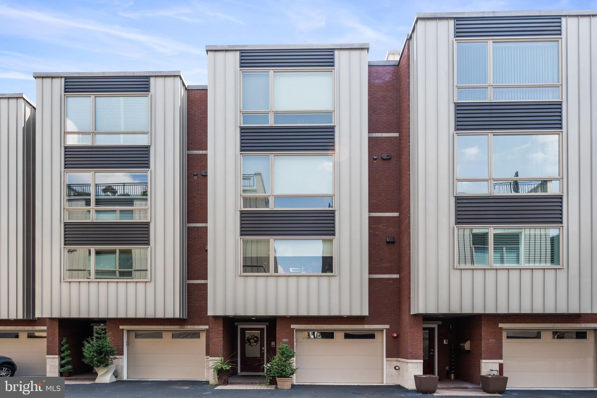Welcome to the gorgeous Residences at Shot Tower Estates, nestled in the heart of Phila's coveted Queen Village District. This magnificent home leaves little to nothing to be desired.  If you fancy to partake in Phila's Lifestyle Community Living Scene, this property provides you the ability to stroll to shopping venues, high rated eateries, Delaware River activities, walking/jogging/biking trails, city/community parks, dog parks & easy access to everything including the Italian Market & Pat's Steaks! If you are searching for a property w/the security of a gated community, 2-car parking & an inexpensive HOA that takes care of your common area maintenance, this property hits the mark! And if you will settle for nothing less than a premium living environment, top of the line appliances & finishings, gorgeous HW & premium flooring, a 5 stop elevator & attention to detail at every turn, then this wonderful property will fulfill your needs! Welcome to unit G.  As you arrive, the electric security gates will open & lead you in. As you pull into your garage & enter, the sometimes chaotic world will be left behind you. Whether you take the elevator upward or stroll on the gorgeous/floating staircase, the main level greets you w/high ceilings, an open-spacious design, large windows providing soothing natural sunlight & peace & quiet. This property is designed into 5 spectacular floors w/4,000 sqft of finished-functional space. The ceilings are high & the flooring is beautiful w/premium HW throughout & tiling in the basement, BAs & utility rooms. The lighting contains state of the art fixtures w/over 100 recessed lights. The flooring layout: Ground level contains the garage, foyer & an in-law suite/bedroom w/a full BA. (can also be used as a den/office/gym).  There are sliders that give access to your backyard patio/garden w/room for entertaining or private relaxation. The 1st floor is home to your LR w/a gas fireplace & oversized sliders to your french balcony. There is a la