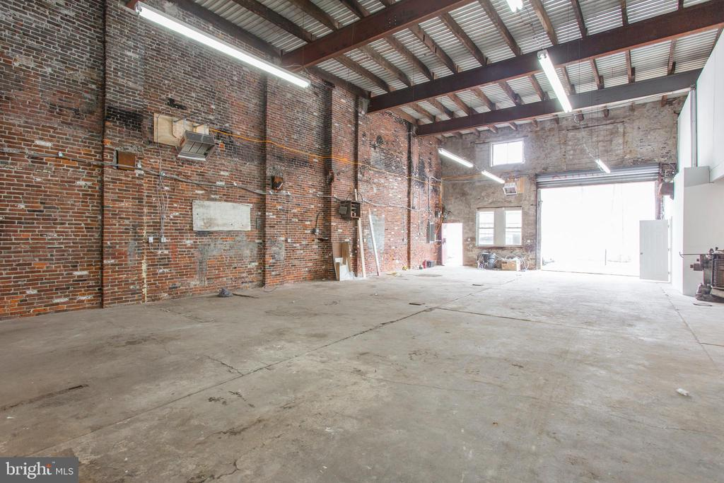 Investor/Developer/Auto Body alert! Huge 5,580 sqft ICMX property in a prime Point Breeze location (just south of Washington ave).  Incredible open space with concrete floors and brick walls. This property could serve as any number of business uses such as automotive, industry, or build out to be an industrial chic office space and also boasts a drive in door.  This property was used a sign company by one owner for 52 years and was rebuilt 10 years ago. It features 2 new gas heaters, upgraded electrical box, wiring, and new lighting. The office and bathroom have been remodeled along with new plumbing and water heater and a new staircase was added in the main floor area to the loft storage area. Also features a new roof and the top wall bricks have been pointed. Located along the Washington Avenue corridor improvement plan which aims to ease traffic, allow easier access to Center City, and revitalize aesthetics. Can be purchased with 1512 Alter and 1500-1510 Alter as a package for 1.9 Million. Come and see it today! (This building was three story and is now two stories - second floor is partial and has storage area)