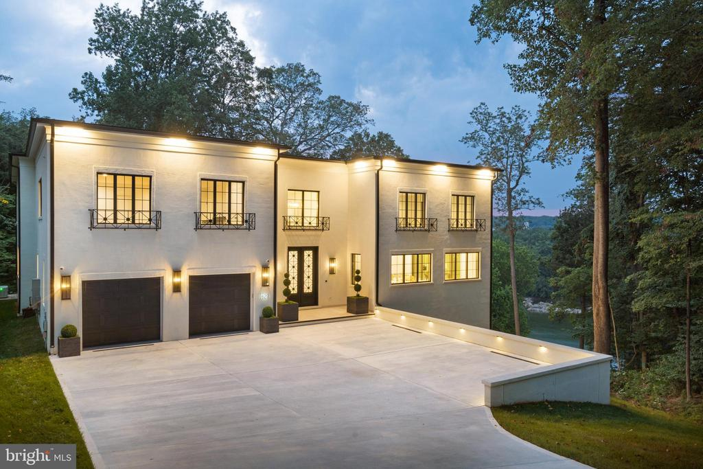 """This private gated river-view estate residence reflects timeless elements of neoclassical design with a distinctly modern edge, newly completed in June  2021.  Designed and built by award-winning Apex Custom Homes, this is an estate for the most discerning owner.  Soaring ceilings, classical millwork, and oversized windows frame sweeping, unobstructed views of the Potomac River.  Massive double doors introduce the entry hall which leads to the great room with soaring ceilings and a wall of retractable glass  doors to the expansive terrace.  Here, one overlooks a most picturesque section of the Potomac River and a constantly changing natural landscape.  The expansive dining room centers on a wall of glass revealing the dramatic wine room.  On the main level, a glamorous primary suite centers on an impressive fireplace and includes dual dressing rooms and a spa-like bath with heated floors, an oversized jetted tub, steam shower and dual vanities.  The custom kitchen  captures sweeping views of the river and features professional BlueStar appliances, including a magnificent 60"""" range.  Upstairs, four additional bedrooms each feature oversized closets and spa baths finished in exclusive Italian ceramics.  On the lower level, an extraordinary game room boasts a dramatic wet bar and entertaining area, oversized fireplace, and direct access to the lower terrace and infinity-edge spa overlooking the river. A home theatre, exercise suite, and a full bedroom and bath complete this level. An additional 1902 unfinished sq ft  is perfect for exercise, a children's play and hobby area, golf simulation at 11.5' ceiling height.  A heated driveway leads to a parking court and an oversized garage with hydraulic lifts for four automobiles.  With a brilliant location convenient to Downtown, Tysons, and Maryland, Rivercrest is unquestionably one of the finest river-front estate residences in Washington. Elevator optional to all 3 floors"""