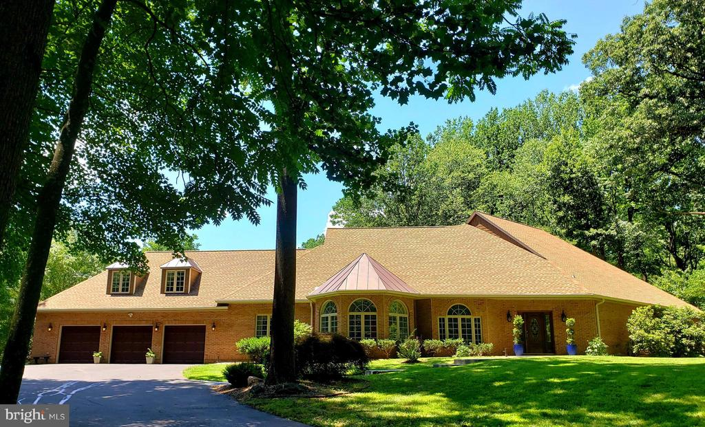 Welcome to Wine & Hunt Country.  This absolutely gorgeous custom brick colonial is located in the sought after neighborhood of Fleetwood Farms.  The neighborhood boasts extensive bridal trails, beautiful views, and easy access to Rte 66.  Located just a short distance to a plethora of the area's best wineries.  Tucked away on a private cul de sac, your just over 10 acre oasis awaits.    As you enter the home you will be greeted by the formal living & dining spaces, with a gorgeous crystal chandelier & brand new Shaw caress carpets.  Straight ahead you will see one of the two stunning floor to ceiling stone  fireplaces located in the great room, a tray ceiling gives this room the perfect finishing touch.  Hardwood flooring wraps around the majority of the additional living spaces on this level.   This lovely home was made for entertaining, with an open floor plan that is full of natural light flowing in through the Pella designer series palladian windows.  The gourmet kitchen presents with 2  separate islands, abundant cherry cabinetry, built in space for wine storage, a wine fridge, a new top of the line refrigerator with easy view door, & craft ice maker,  wall oven/microwave, JennAir down draft range, prep sink, & electric cooktop.  Recently updated, the kitchen has honeycomb marble mosaic back-splash, & new flooring.  Just around the corner is a large custom pantry with a secondary full-size refrigerator.  The kitchen opens to the sun room, this can be used as a functional living space or second dining area.  The second of 2 stone fireplaces is located here.  It is a great place to sit and enjoy the view of the gardens, & a rare 30+ year old picturesque maple tree which is the cornerstone of a stamped concrete courtyard. Relax & take in the daily show the hummingbirds put on just outside the windows.  Off the sun-room, there is a separate fully functional office space with cherry cabinetry, b/in  desk w/space for all your supplies.  A short hallway leads to the h