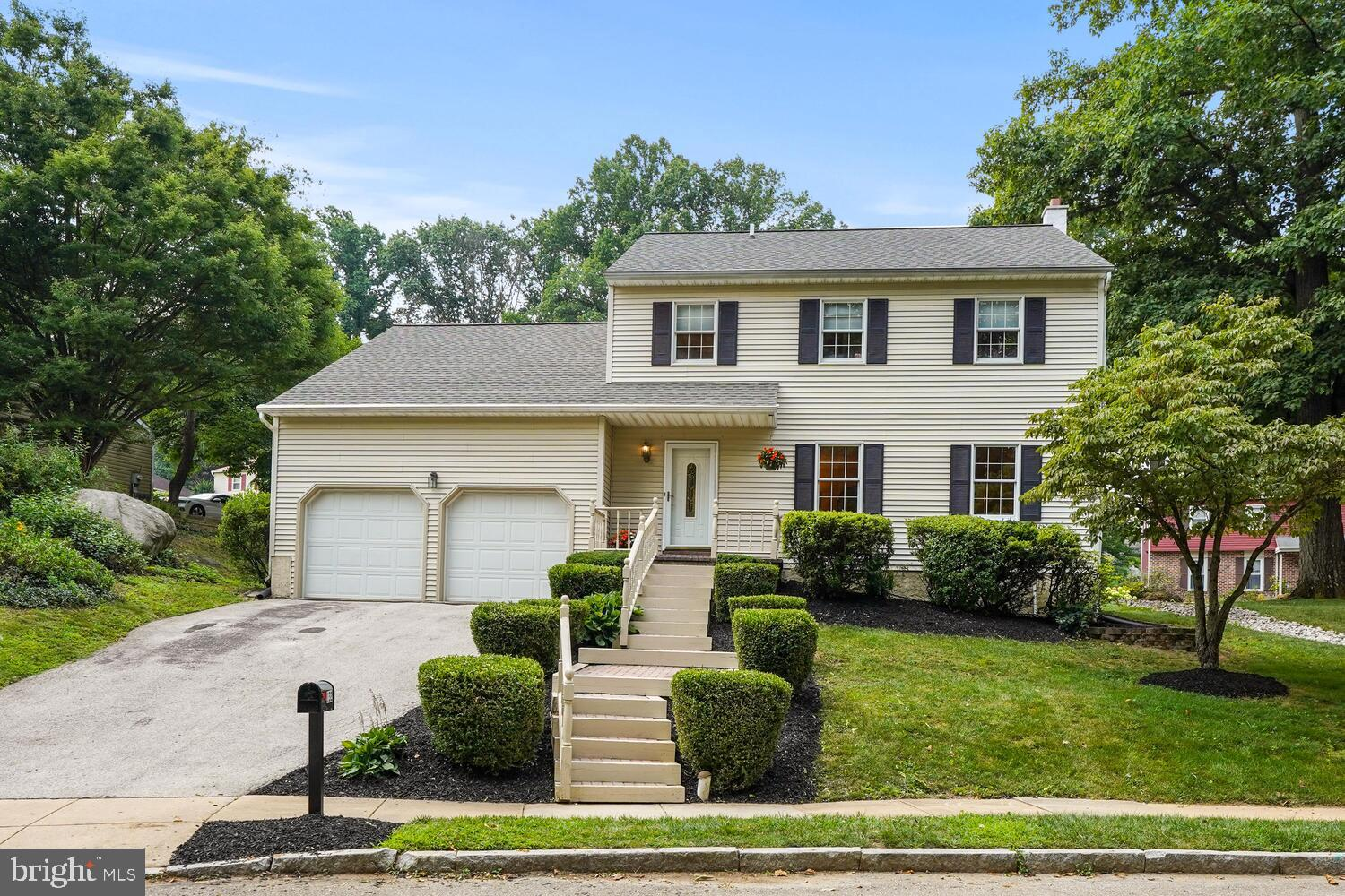 Finally, a spacious and affordable colonial in Radnor township. This sun drenched home  has a spacious living room that leads to a dining room, making a perfect space to entertain. The eat-in kitchen with Kraftmaid cabinets, granite countertops and stainless appliances leads into a newly carpeted, fireside family room. There is a full finished basement which can be additional play space or man cave. The second floor has 4 nice-sized bedrooms with 2 full baths. The primary bedroom has a custom closet and full bath. Enjoy spending time outside in this quiet neighborhood from your back patio and yard. There is tons of open space in the common area next door as well as across the street. This home is located in the top rated Radnor Township School District and is a short distance to Wayne Elementary School, parks, the Radnor walking train and convenient shopping.