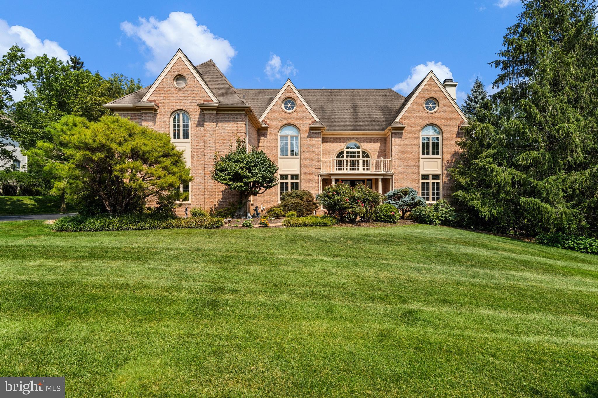 This stately, brick 5 BD, 4/3 BA manor home is nestled on Van Lears Run in Villanova, a quiet cul-de-sac street in a prestigious Radnor Township neighborhood. Located near the Ardrossan Estate, this property is convenient to the Blue Route, Center City, and Airport. The level, nearly 1 acre yard features flowering shrubs, mature specimen plantings, and sweeping expanses of manicured lawn for recreation. The light-filled, 2-story Entrance Hall features large arched windows, a curved staircase, and marble flooring. Entertain guests in the gracious Living Room with fireplace, followed by meals in the large formal Dining Room, which has an adjoining Wet Bar, complete with a wine frig & glass-front cabinets. Work from home in the private, 1st floor Office/Library, which also has built-in shelving. The soaring Family Room is perfect for relaxing and features a cathedral ceiling with skylights, exposed beams, and a 2nd fireplace. You'll never run out of storage or counter space in the large Kitchen, which features cherry cabinets, gas cooktop, double wall ovens, microwave, and a large stainless refrigerator. The vaulted Breakfast Room and barstool seating at the island offer ample space for casual everyday dining, and a built-in desk is ideal for menu planning or homework. The Mudroom and Laundry Room are located near the oversized 3-car Garage. Formal and casual Powder Rooms and more closets complete the 1st floor. Upstairs, a curved 2nd floor balcony with pillars overlooks the Family Room. The Master BD suite has a large sitting room, tray ceiling, 2 walk-in closets, luxurious Master BA with large tub & separate shower, and a private staircase to the 1st floor. Bedroom 2 has an en suite full BA. Bedrooms 3 and 4 share a large Jack-n-Jill BA. The 5th Bedroom and 4th full BA are in the walk-out, daylight Lower Level. This area would make an ideal in-law suite, since it also features a large Recreation/Family Room with fireplace, another Wet Bar, closets, and a 3rd Powder R
