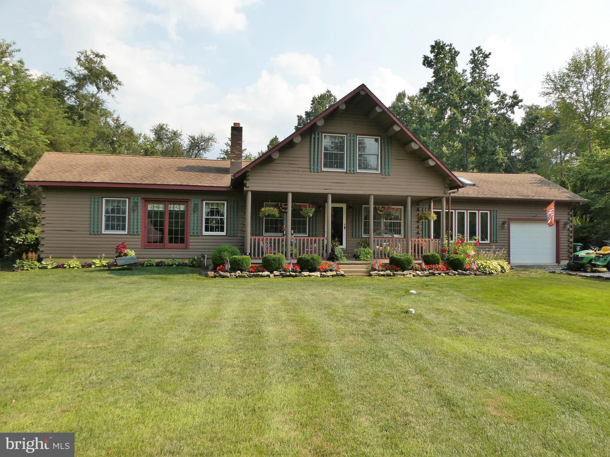 """Looking for your own Piece of Paradise!  This is it!! This impeccable two story """"Log Cabin"""" style house on almost 1 acre.  This is your dream come true.  Three bedrooms, two baths, master suite with walk in closet and 19x12 sitting area.  26x13 great room with a brick fireplace.  22x14 kitchen, 14x12 sunroom.  Massive open ceiling with real log beams.  24x17 loft. Gorgeous hardwood floors as well as ceramic floors throughout.  Partial basement, and an attached 1 car garage.  Meticulously manicured landscape.  Spacious deck overlooking a park like setting rear yard with a heated 20 x 40 inground pool!  This is one not to be missed.....Hurry! All appliances are included."""