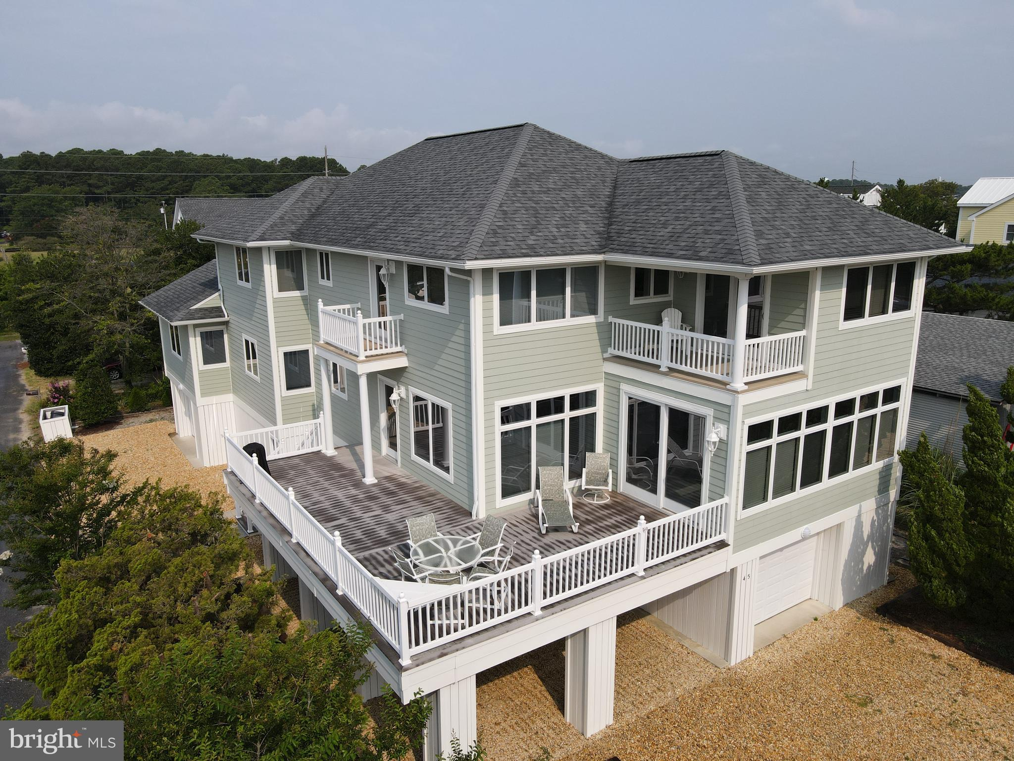 Beautiful 6 bedroom home located just one off the ocean in the sought after community of Middlesex Beach. This custom built coastal retreat features ocean views from almost every room in the home. On the ground level you will find covered parking for 4 cars with additional parking for 4 more cars on the exterior, 2 large outdoor showers, a 1/2 bathroom perfect for running back and forth from the beach, a large storage and utility room with workbench and additional refrigerator to store all of your beach gear, bikes, etc... and access to the elevator. As you enter the 2nd level you will step into the great room featuring an open kitchen, living and dining area. This huge space is perfect for large gatherings and entertaining. Features include a massive wet bar, gas fireplace, large kitchen island and separate dining area. Step out onto the wrap around deck and take in the ocean views and feel the ocean breeze. Also on the 2nd level is a powder room, laundry room, 2 bedrooms with full bathrooms and a flex room that is currently set up as an office space / game room / library / tv room.  On the 3rd level you will find 4 more spacious suites. Two have private balconies, one has a built-in nursery and another has its own study.  The 3rd floor hallway features a kitchenette, prefect for late night or early morning drinks and snacks. This home has never been rented and has served the same family who built it in 2001. Recent improvements include a new roof in 2020, a new hot water heater in 2021, and new outdoor lighting in 2021. This home is selling fully furnished. Don't miss this opportunity to own your own piece of paradise in Middlesex Beach!