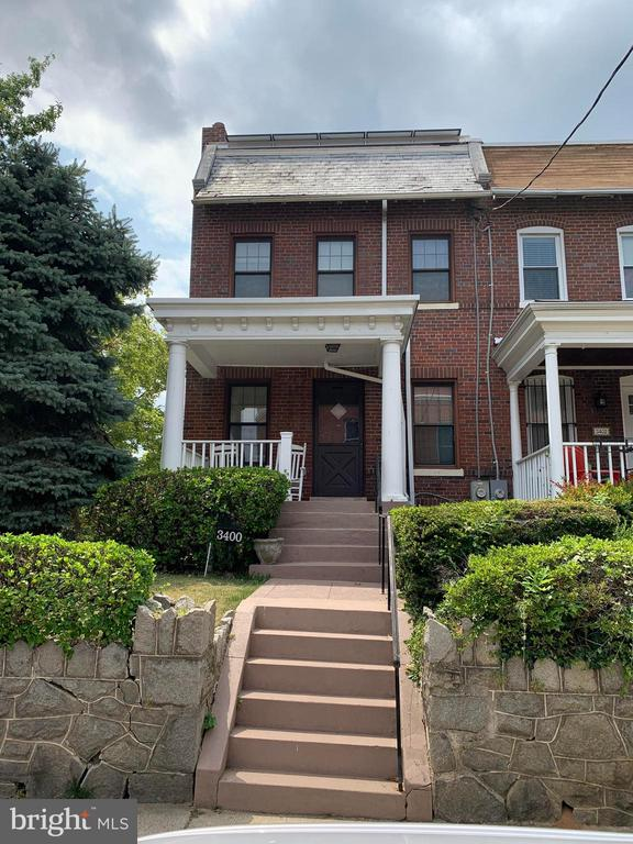 Great location in Brookland, section of Washington D.C., Spacious brick end unit row house with originally 3 bedrooms now converted to 2 Bedrooms, 3 full bathrooms, 3 levels of living, central A/C, electric fireplace, large deck, front porch, fully finished walkout basement, solar heating system, driveway parking and attached 1 car garage. Close to red-line commuting at the Brookland-CUA metro station. Close to restaurants on 12th street, shopping at Monroe Street Market, close to recreation center. OPEN HOUSE SUNDAY 12-4:15 PM.
