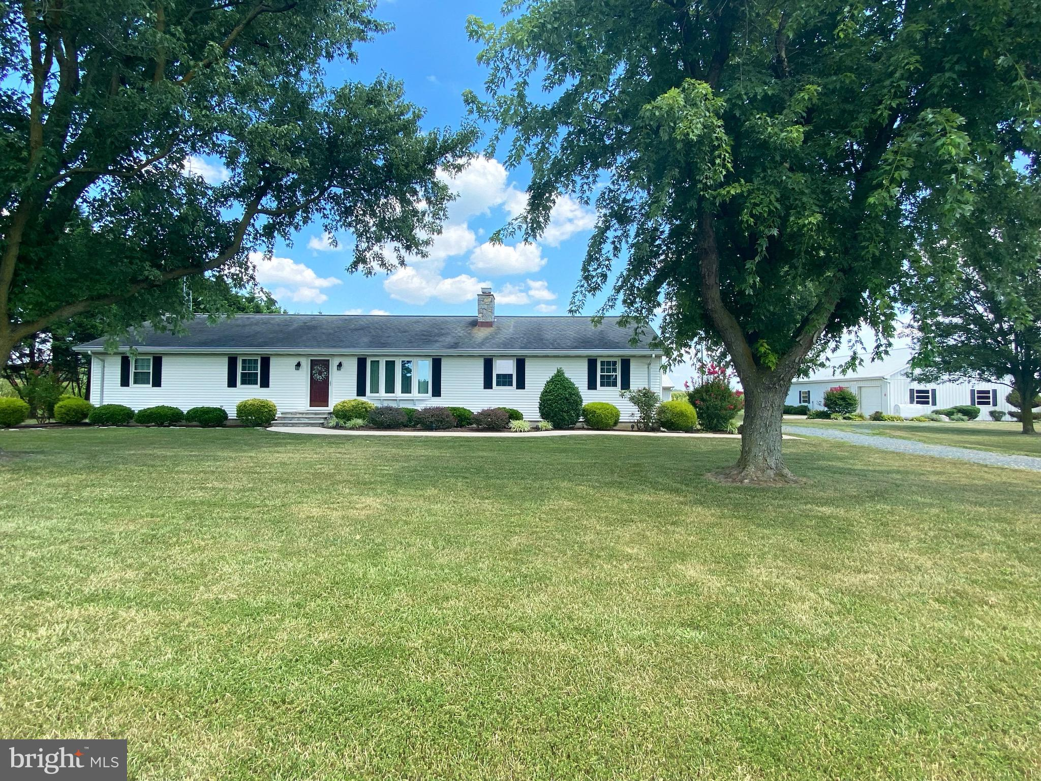 This two parcel property includes 2.32 acres with a 1700 square foot rancher and 3 outbuildings with a total of 13 bays. Buildings are labeled by A, B and C.  Building A is 30x40 with a two car garage and additional storage area with a lean to off the back. Building B is 30x60 with 2 bays on one side and 5 on the other. Building C is 30x76 built in 2010 with 5 bays, one of which is sized for a RV or bus. Building C also has a 14x76 covered lean to off the back. All building have electric and heat.  The rancher is a 3 bedroom, 2 full bath 1700 square foot home built in 1982 with a gorgeous gas fireplace and a large sunroom off the back. Composite decking off the back over looks the fields and gorgeous landscaping.