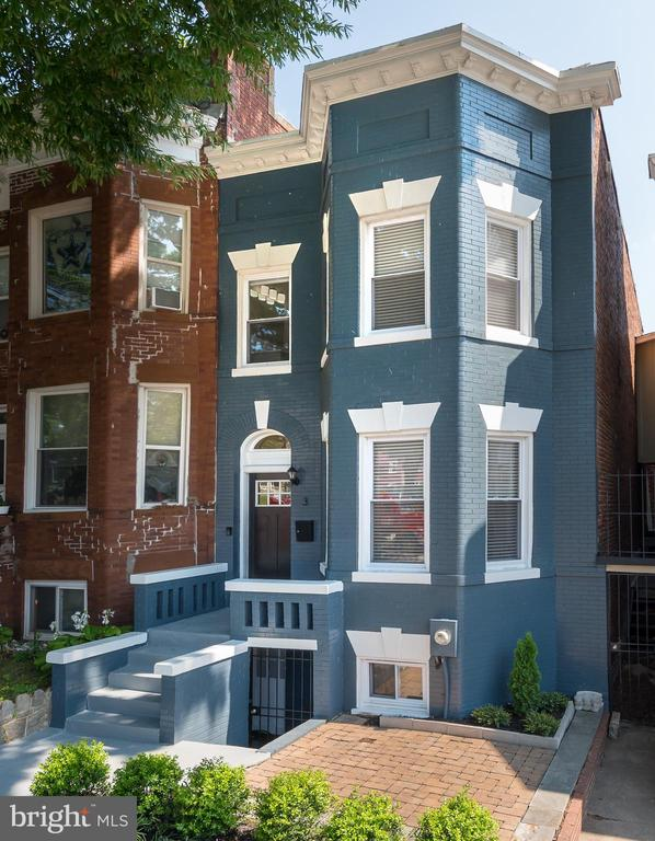 **NEW PRICE! **  Beautifully renovated & spacious 3BR/3BA home flooded with natural light plus newly finished lower level In-Law/Studio Apartment with private front entrance (easily rents for $1500-$1600/mo).  Wonderful classic detailing throughout includes original trims & mouldings, high ceilings, gorgeous original central staircase, multiple exposed brick walls meticulously repointed & sealed plus beautiful original hardwood flooring  with stunning rich patina.  Bright and spacious chef's kitchen featuring quartz countertops, custom cabinetry, stainless steel appliances, large farm sink and gas cooking.  Inviting sunny rear deck just off the kitchen is perfect for entertaining.  Walking Score 90.  Just blocks to beautiful Crispus Attucks Park, The Red Hen, Bacio Pizzeria, Big Bear Cafe, the Bloomingdale Farmers Market and Harry Thomas Recreation Center w/public pool, tennis courts, basketball courts and playground.  The newest neighborhood addition is Eckington Yards w/Brooklyn Boulders  & Union Kitchen with more to come!  Super convenient bus stop on the corner with quick direct access to downtown, an 18 minute walk to NoMa/Gallaudet Redline Metro or jump on the Metropolitan Branch Trail just a few blocks away.