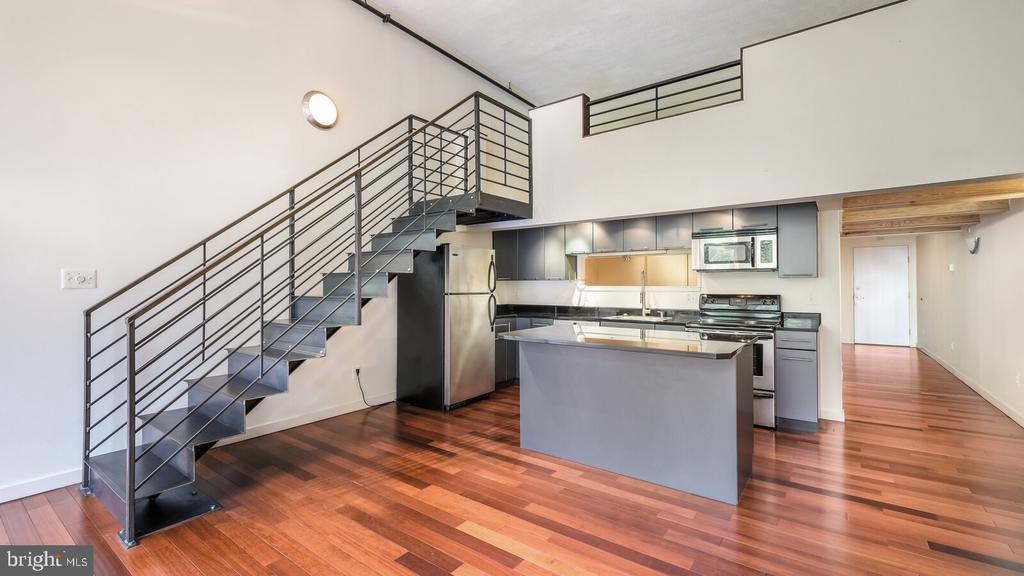 Welcome Home to this Spacious 2 Bed/2Bath Bi Level Loft Condo at the Pitcairn Building located @ 1027 Arch Street Lofts. 15 ft High Ceilings, Enormous windows with plenty of light!  Main level includes Custom Mahogany hardwood floors with open floorplan for the  kitchen and living area. Kitchen outfitted with stainless steel appliances and custom Island with Granite Counters. The  main level is complete with a bedroom, full bathroom with tub/shower, large laundry-closet area. Custom Steel staircase leads to the second 'mezzanine' level with open lofted bedroom area, full bathroom with  Tiled shower and Frameless Glass Doors, and mechanical room with plenty of Storage space. The Condo has a new HVAC system  and newer Hot Water Tank! 1027 Arch is centrally located on the Cusp of China Town and across the Street from the Convention Center. Enjoy the Reading Terminal Market, Trader Joe's on Arch St, the newly opened Fashion District with shops and AMC movie house! Trendy restaurants, shopping and more. Easy access to bus lines and trains as well as major highway. Seller has installed new neutral carpeting in the Loft Bedroom area. Vacant and Easy to show! What a wonderful place to call home!