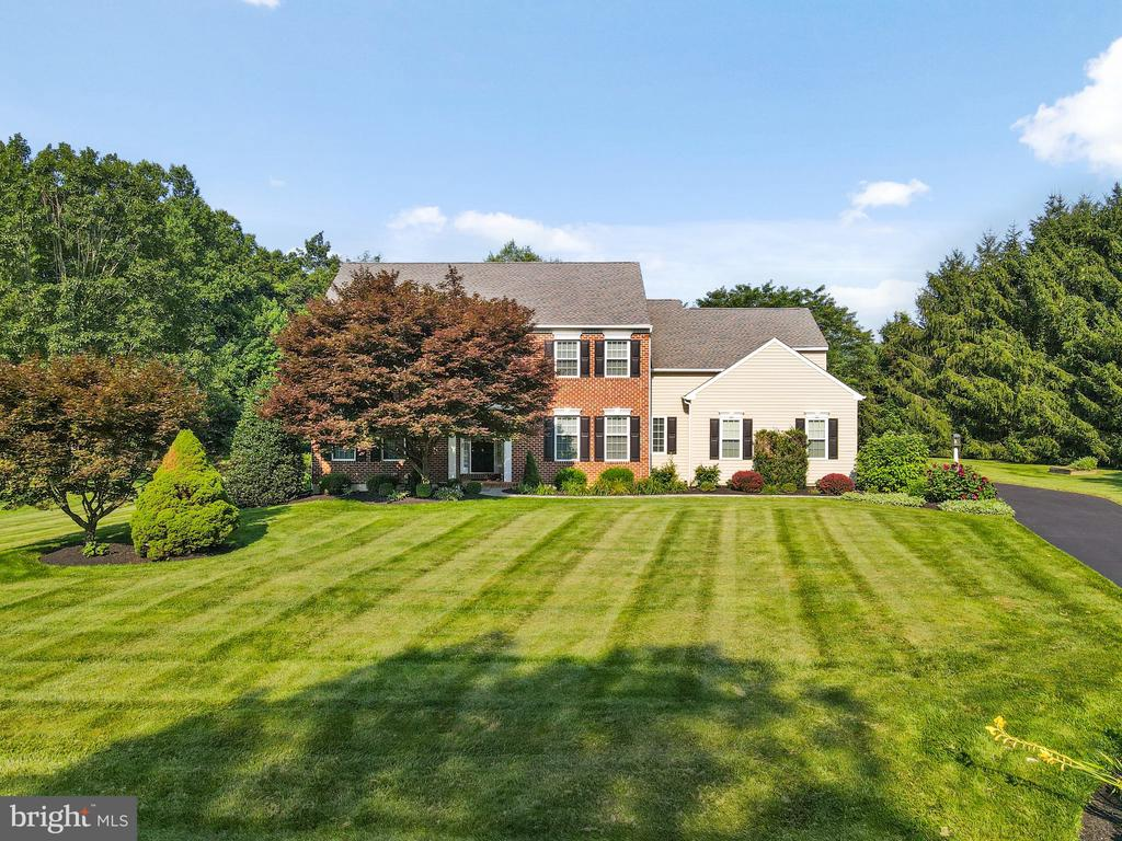 ***Multiple offers received. Requesting best and final offers by Monday, August 16th at 5:00pm.***  Welcome to 25 Yarmouth Lane in the award-winning Downingtown School District! Upon arrival, you will be amazed by the flat, sprawling 1.8 acre lot with woods in the rear. The exterior of the property has been meticulously maintained with new construction windows throughout, incredible hardscaping, and a spacious 3 car garage. As you step inside this 4 bed / 2.5 bath colonial, you will be met with a number of upgrades including: a Holiday Lighting package, a professional 6-burner range, a built-in refrigerator, large lighted pantry, beautiful hardwood floors, high ceilings, a full finished basement and so much more. As you make your way upstairs, you will be greeted by 4 spacious and well-appointed bedrooms.  The master bedroom has incredible detail and gives way to a gorgeously redone master bath and walk-in closet.  25 Yarmouth Lane also utilizes a very efficient geothermal heat system for total comfort year-round. Incredible upgrades, a quiet neighborhood and a top-rated school district truly make this home a must see!