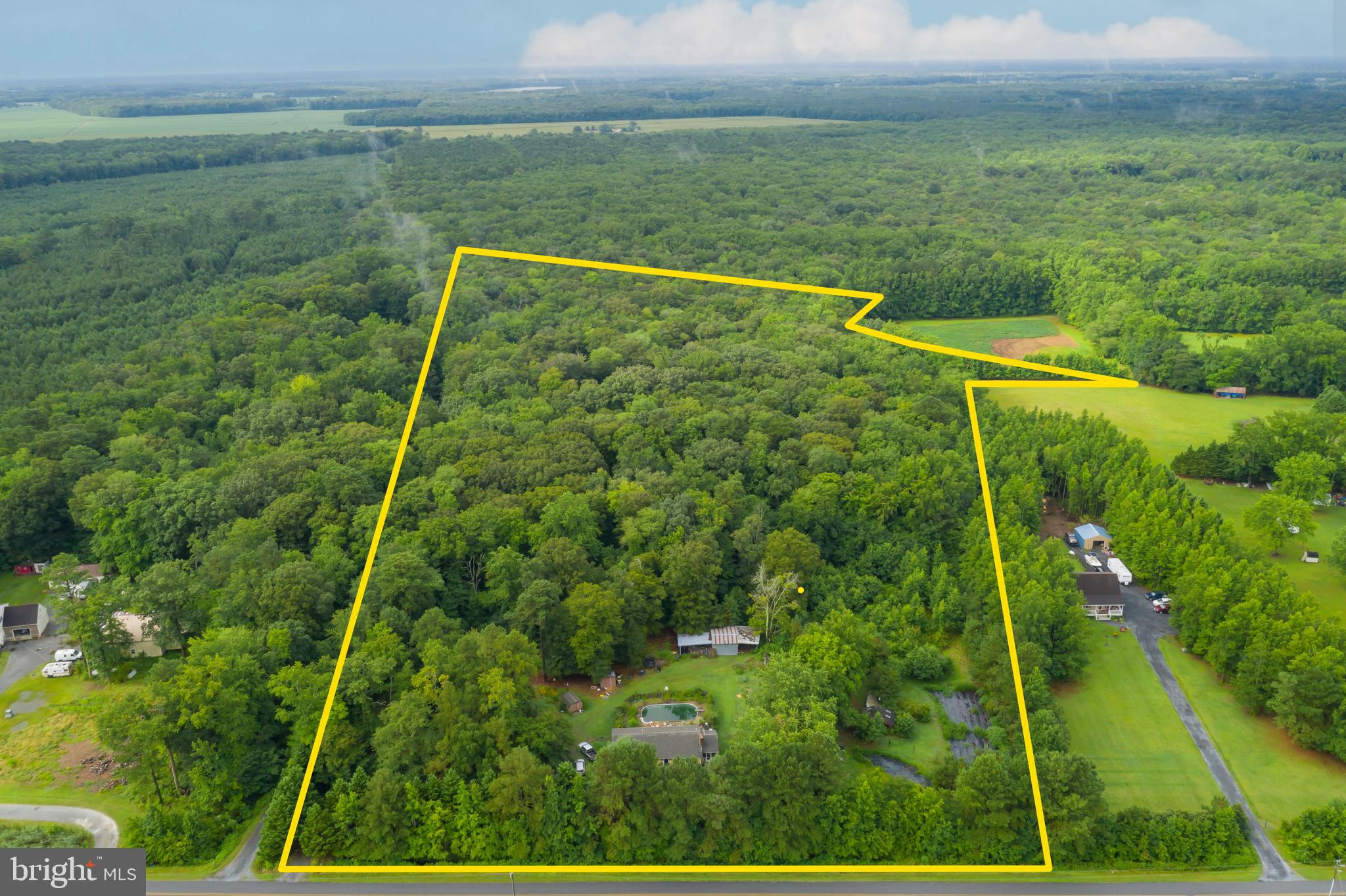 Opportunity abounds on 17.48 acres at 9036 Peerless Rd Whaleyville, MD. This property offers seclusion and is ideal for hunting, horses, trail riding and gardens all within 13 miles to the Ocean City beaches. The 3 bedroom 2. 1 bath home has a kitchen with an open dining, living room, gas fireplace, screened porch, and back yard deck with an in-ground pool. The home site includes a pole barn, pasture and barn, fencing, fishing pond and a kio pond. New roof in 2019. This is an Estate Sale and is being sold As-Is.