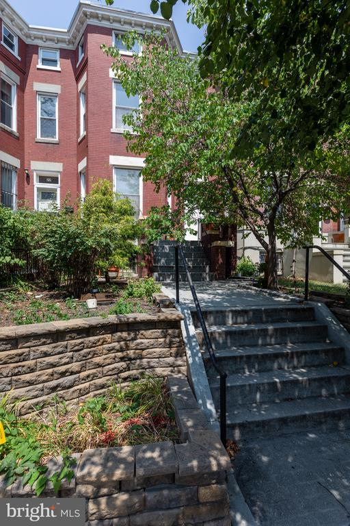 Wonderful row house with separate basement apartment. Great investment property in sought after Eckington! Upstairs offers an open floor plan with high ceilings. Main level has lots of natural light with the south facing living room, half bathroom, spacious dining room, and open kitchen with island and great cabinet space, plus access to the back patio and one off street parking spot. Go up the stairs to your 3br, 2ba, and convenient W/D. The main suite has a walk-in closet, spa like bathroom with dual sinks, separate shower and soak in tub. The main bedroom has high ceilings and a terrific loft for extra living space! The basement has a certificate of occupancy and includes 2br, 1ba, living and dining area, kitchen, and W/D.  Fantastic location- Walk Score 93, Bike Score 91. Less than one mile from 3 different metro stops (0.6m to Noma Metro stop, 0.7m to Shaw-Howard University Metro Stop, 1m to Rhode Island Ave Metro Stop). 2 blocks to the Harry Thomas Recreation Center (pool, playground, tennis and basketball courts), and blocks to restaurants, shops, bars, entertainment &  groceries (also 0.7m to Trader Joes).  Both upstairs and basement are rented out.