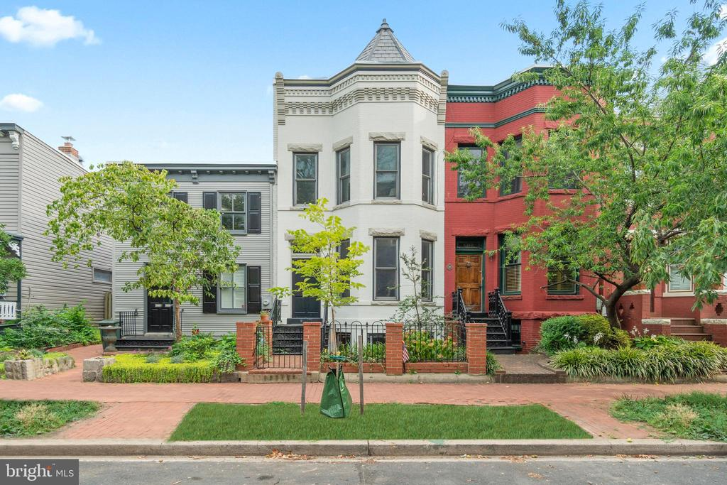 Offers due 8/31 at 2 PM. Massive, grand, turreted and stunning 1900 brick and stone Edwardian bayfront with separate, fully and beautifully renovated English basement apartment containing a full kitchen with granite and stainless steel and washer/dryer, plusbeautifully renovated, oversized garage on a huge 16 foot wide lot in the heart of the historic district, one and a half blocks from Eastern Marketand two and a half blocks from Metro, boasts original vintage period detail including high ceilings, huge windows, antiquehardwood floors, staircase and balustrade, fireplace,skylight, transoms, clawfoot tub and pedestal sink, stylishly updated with granite, stainless,crown molding, designer lighting, custom hardwood cabinetry, wet bar and wine fridge, dual-zoned A/C and landscaped private flagstone patio.Garage re-done 2016, New roof 2019, New Dual HVAC and fully renovated BSMT apt in 2020. Current configuration of two separate units with Certificate of Occupancy has great income-producing potential.