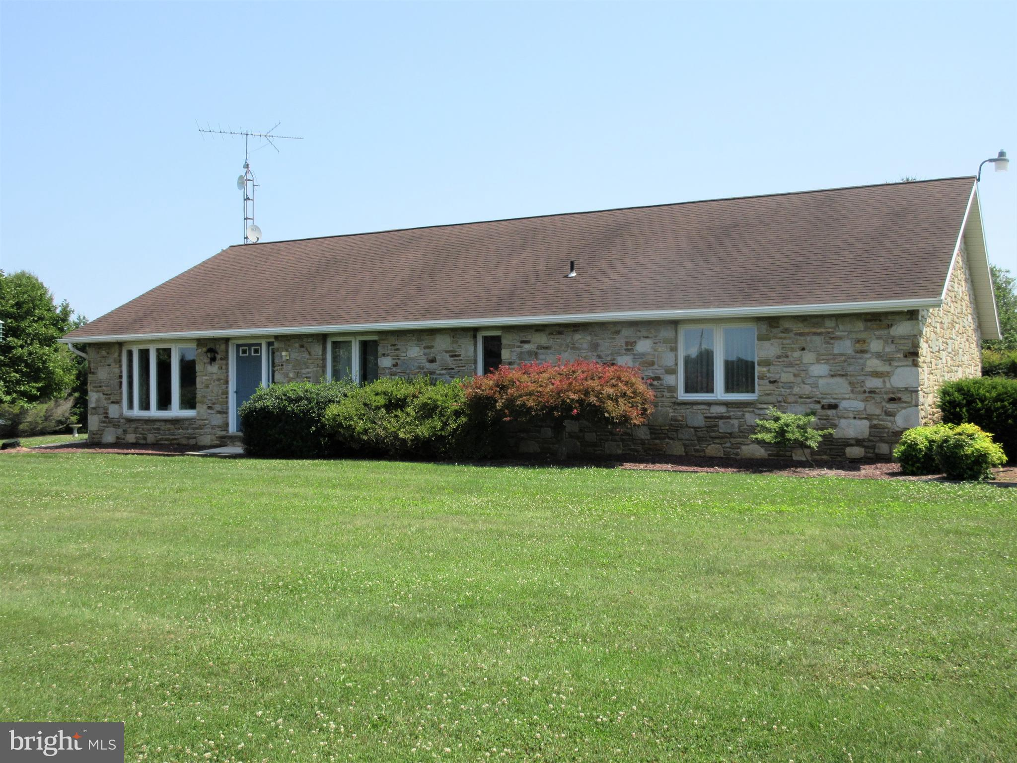 3/5 Bedroom Butler stone rancher on 3 acres surrounded by farmland! All new Anderson windows and a new geothermal heat system or great efficiency! Large wood burning fireplace with wood insert.  Sewing/craft room and office could easily become bedrooms 4 and 5.  Large first floor laundry room with sink and lots of cabinets. Peaceful country views. Great location for a large garden and bring your animals. Jenn air grill corian countertops, lots of cabinets, refrigerator and double oven in kitchen.  Large basement with 8 foot ceilings includes indoor horseshoes/golf driving range with net-archery pit 50 feet long with 14 foot ceilings, pool table and air hockey table included. Sewing/craft room, laundry room. 2 walk up attics, large shed, chicken house. Above ground pool. 3 outdoor horseshoe pits with lights might also make a good tennis court or archery range. One year home warranty included with full price offer. Tenants are moving out by end of September.