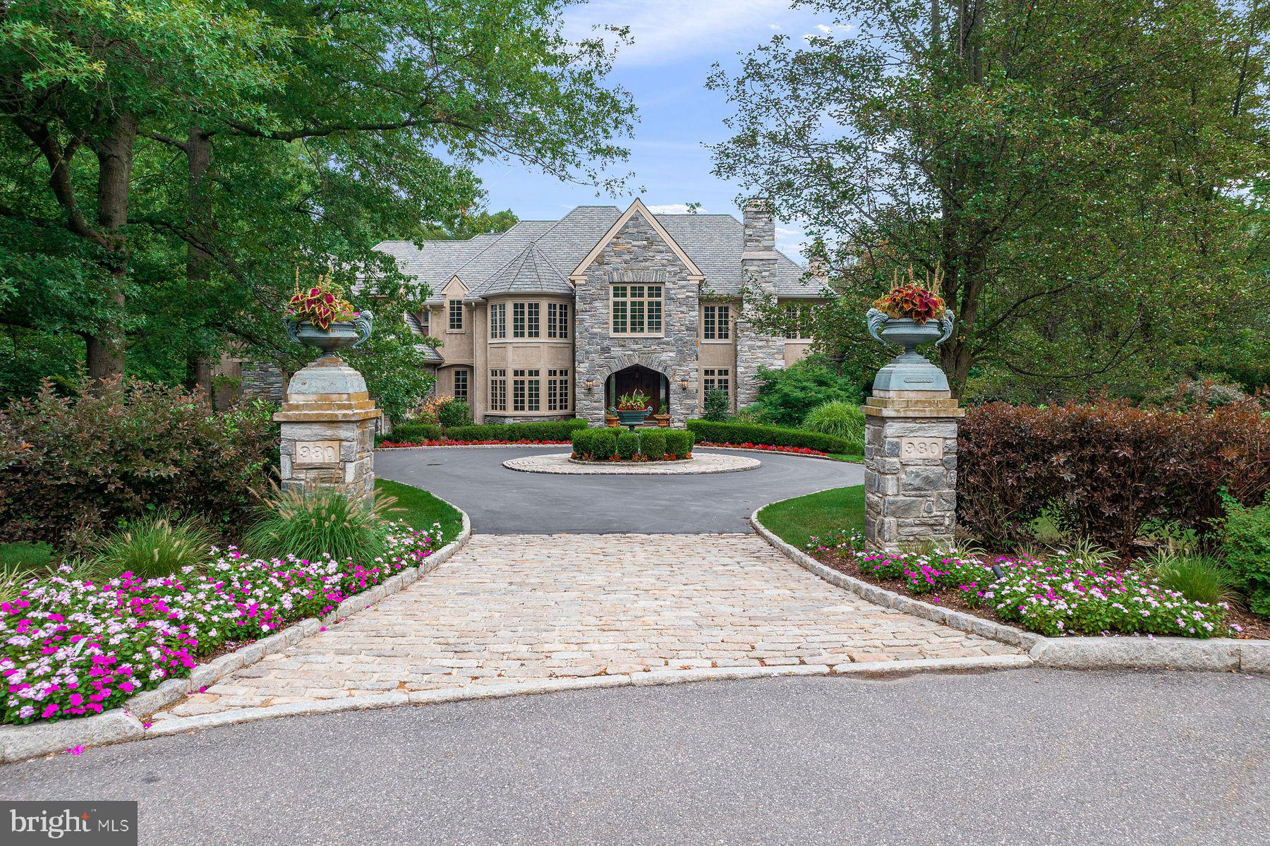 Welcome to one of the most spectacular estates in Gladwyne. This stately property  was  impeccably crafted by renowned builder C.F. Holloway and  is majestically set on a breathtaking 1.6 acre cul-de-sac lot in Gladwyne's premier walkable neighborhood. Look no further and enjoy the graciously designed circular  entrance with stone pillars, Belgian block courtyard detail, stunning landscaping and hardscaping, dramatic entrance foyer with soaring  10' ceiling heights and sweeping curved staircase, bright sun-filled windows with private views, an open floor plan with generously proportioned  rooms catering to comfortable living and effortless entertaining, beautiful cherry floors, hand crafted moldings,  casements and millwork, sophisticated  architectural details, designs, superior finishes and  materials throughout. Move right in and enjoy the inviting living room with gas fireplace and  dining room with bay window flowing off of the impressive foyer, fabulous gourmet kitchen with adjacent breakfast room, family room and screened in porch, beautifully appointed library with fireplace, second home office off of kitchen/ mudroom/ back entrance, expansive master suite with 3 walk in closets, perfectly sized bedroom  with trayed ceiling, gas fireplace and luxurious marble bathroom with gas fireplace, exquisite custom vanities, soaking tub and frameless glass shower. The second level is completed with 3 additional large bedrooms, all with en-suite custom baths, outfitted walk in closets and one with an en-suite playroom/ office. The third floor is easily accessed with an open staircase and offers two generously sized rooms, a fully roughed-in bathroom, walk-in closet and cedar closet. The lower level offers additional, expandable living space including a walk-out and day- lit full media room with full wet bar and conditioned wine room, full bathroom, second laundry hook up and easy access to the serene backyard. This jewel has it all  and is located within walking distanc