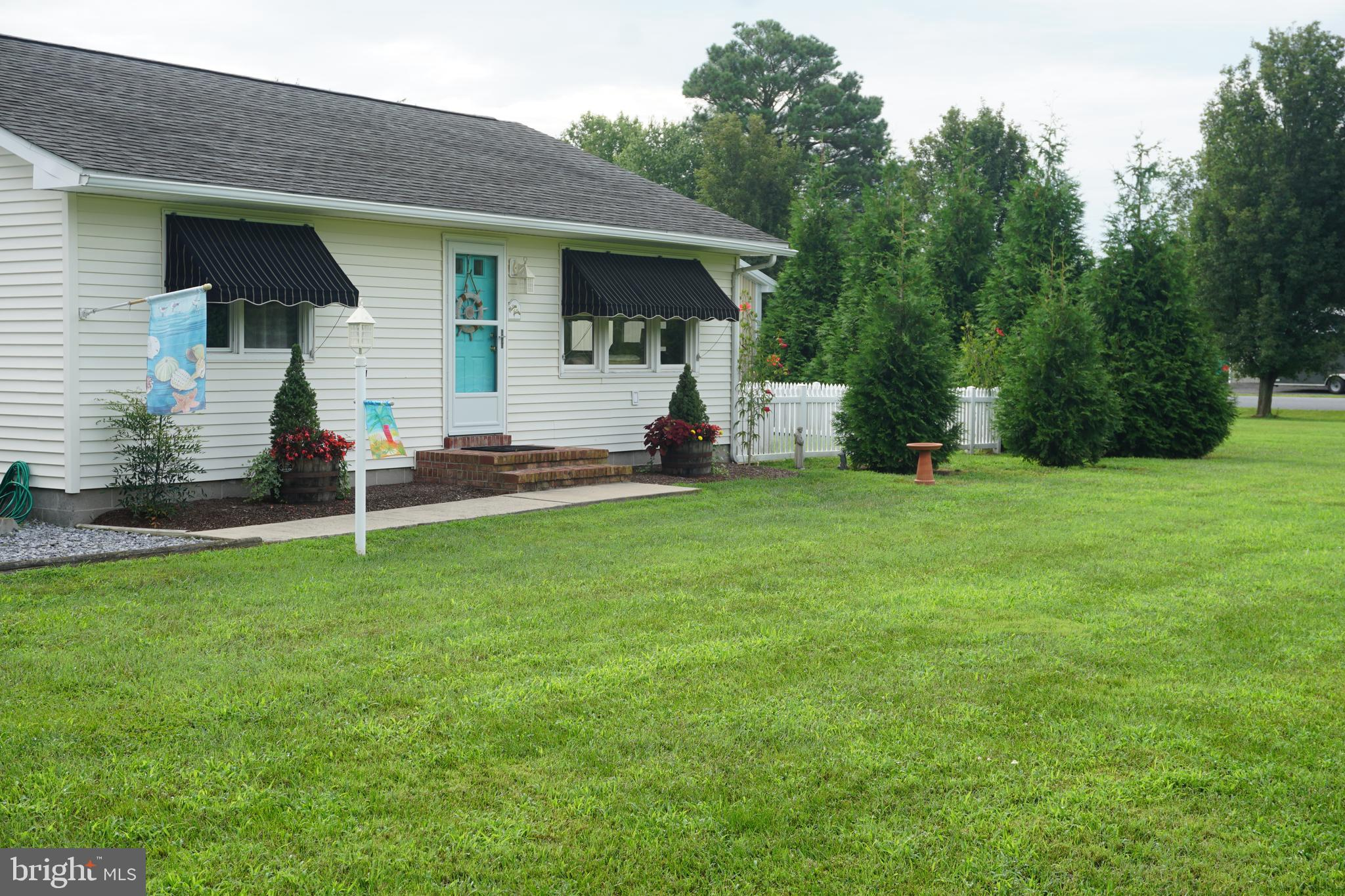 Great opportunity for a unique property 1.09 acres in the Town of Ocean View. Zoned residential with conditional use for commercial in place. Overextended pole barn with 2 offices, full bath,  laundry and room for all your business needs.  Additional 3 car garage. Delightful 2 bedroom , 1 bath cottage with newly remodeled kitchen. Courtyard with grilling area and hottub. Lots of parking . Lots of possibilities await you in this prime growing location. Please review the attached conditional use guidelines in place. Make your appointment to see this very unique property.  37945 and 37949 Muddy Neck Road sold together