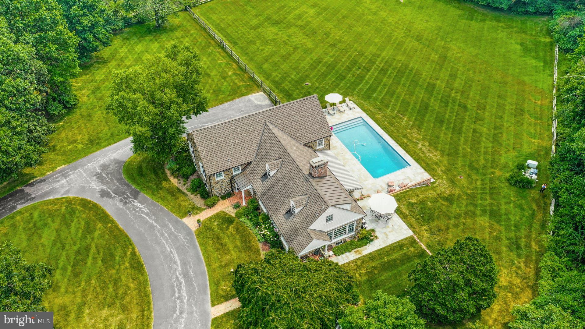 Located on sought after Greenbriar Lane, a quiet private cul de sac in Willistown Township. This house will not disappoint!! Drive in the majestic circular drive to this charming stone home where the covered portico welcomes you.  If this home wasn't originally built by Brognard Oakie, it certainly was inspired by his designs.  Walk into the brick foyer and step down into the huge living room with wood burning fireplace and beamed soaring ceilings. The French door opens to the beautiful flagstone, awning covered patio that leads to the beautiful pool, decking and grounds beyond.  The wonderful flow of this home continues to the light filled dining room whose Dutch door opens to its own patio and views beyond.  Circle back around to the incredibly efficient kitchen which runs along the front of the home.  The main bedroom suite is its own sanctuary with its own private office or den,   large walk in closet and gorgeous bath.  2 additional bedrooms, each with breath taking views and hall bath complete this floor.  The next level houses a large 4th bedroom and luxurious bath, could be an additional main bedroom or a bonus/ playroom or guest suite.  The lower level features a family room, full bath a good size laundry room plus access to the attached 2 car garage and basement with plenty of storage.  This magnificent property has been professionally landscaped and maintained,  4 Greenbriar lane is extremely private yet convenient to all the Main Line has to offer and provides easy access to the Paoli Amtrak and Septa station, Radnor Hunt, Waynesborough  Country Club, premier shopping  and schools.. A One Year HSA Home Warranty will be given to the Buyer at Closing....