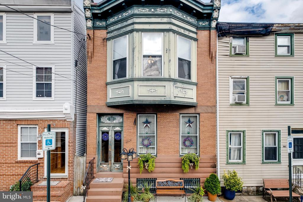Here it is… That old city charm and location you've been waiting for!  Welcome to 1241 Fletcher Street located in the heart of Fishtown. This home is BURSTING with the character and originality that is so hard to find these days! Upon entering through the front double doors, you will be greeted by a gorgeous vestibule complete with original tile and detail sure to leave a lasting first impression. Notice the high ceilings as you enter into the living area with original hardwood flooring and a spectacular fireplace mantle with brass mirror.  Walk through the beautiful solid wood pocket doors and enjoy the luxury of a spacious formal dining room with continued original flooring and neutral paint colors. The large eat in kitchen is complete with stainless steel appliances and plenty of cabinet and counter space. There is a second main level fireplace and mantle that will grab your attention as you head up the wooden staircase full of original detail. Located upstairs are four bedrooms, each with their own unique qualities to love… such as that amazing built- in wooden armoire with window seat! The upstairs full bathroom contains some original tilework and vintage claw foot tub. Last, but not least, step out to the large backyard that is fully cemented and provides perfect privacy with white vinyl fencing and your very own off- street parking…. Yes, your very own off- street parking spot!  This home is full of amazing detail and bonuses that you won't easily find elsewhere. Schedule your tour of this vintage beauty who is waiting to meet the next owner!