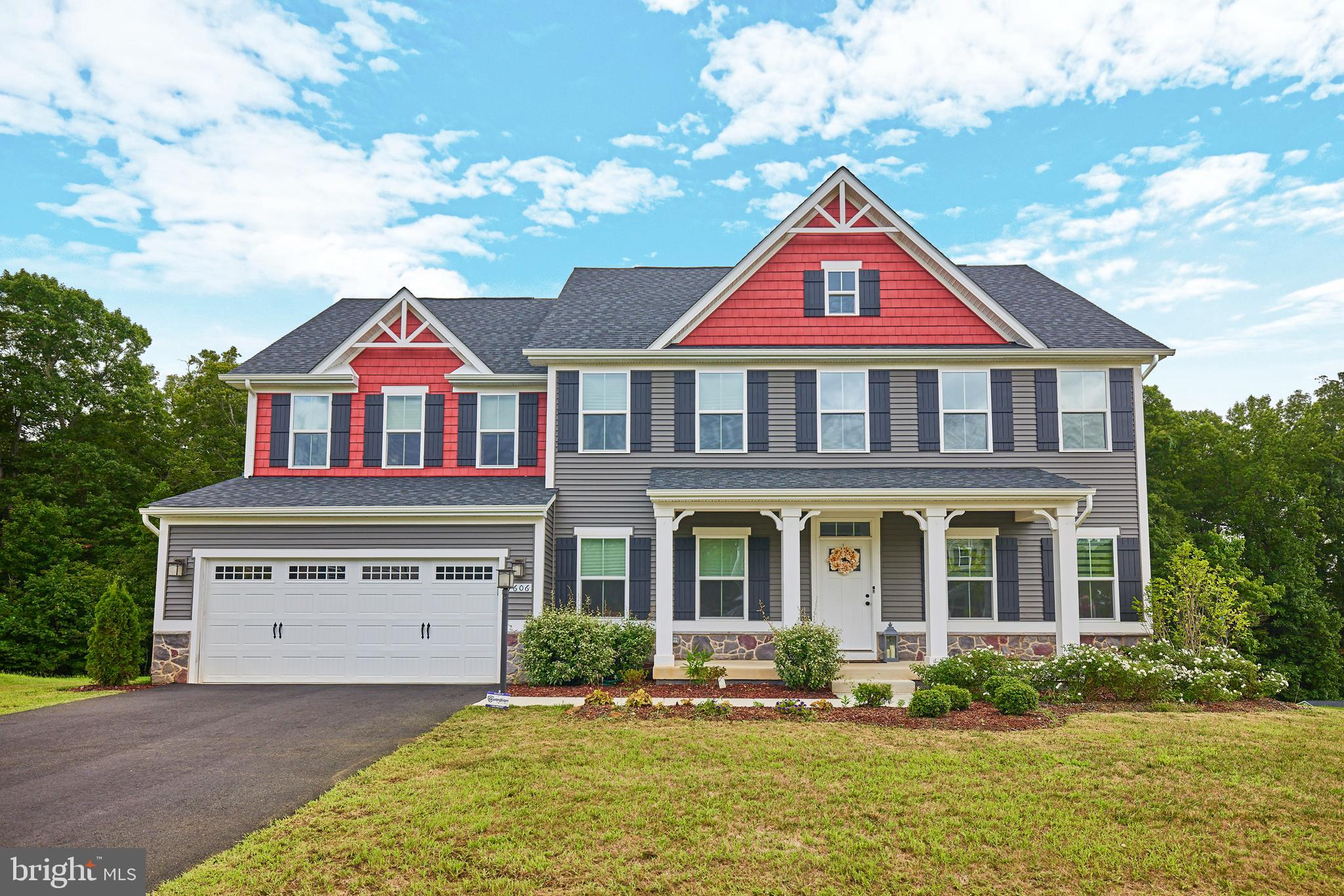 Why wait for new construction?! This gorgeous 2019-built, 4,700 SF home with 5/6 bedrooms (including one on the main level with its own bath) is in the highly-desired neighborhood of The Crossings of Chancellorsville and is located in the Chancellor Elementary (a Blue Ribbon School) and Riverbend HS pyramid. Upon arriving at this premium cul-de-sac lot location, the lighted front porch welcomes you as you can take in the curb appeal of this stunningly built Normandy model by Ryan Homes. As you enter, the first thing that will draw you is the openness of this floorplan.  The main level features  a dedicated office space with glass french doors, large dining room, in-law suite, mud room, and a gourmet kitchen with breakfast area suited for the entire family to gather.  The gourmet kitchen offers a gas cooktop, double oven, stainless steel appliances, and upgraded cabinets with granite countertops. The massive island, with seating for 4, overlooks the expansive light-filled family room that boasts a gas fireplace that will make your jaw drop--truly the perfect floorplan to entertain with enough space for everyone to be together while overlooking the .75 acre backyard that would be perfect for an in-ground pool.  When it's time to retreat for the evening, the open staircase has oak floors and is flooded with natural light as it leads you upstairs where you will find ANOTHER living area.  The generously sized owner's suite is tranquil with its lighted tray ceiling, two large walk-in closets, and a private bath with a soaker tub and separate shower!  Additionally, on this level, you will find 3 more generously sized bedrooms also with walk-in closets (one bedroom with it's own en-suite bathroom), a hall bath, and laundry room. The large recreation room in the walk-out basement offers tons of potential! Mostly finished with a full bath, accompanied by a massive unfinished media room and bedroom currently being used for storage, there is plenty of space for guests, a playro