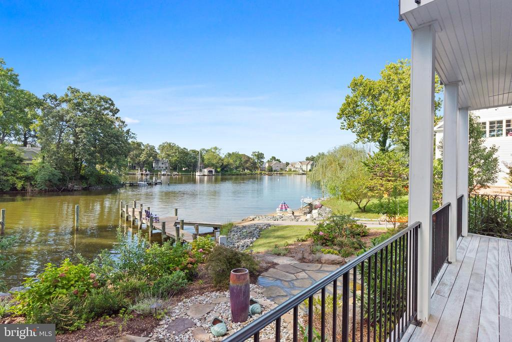 Opportunity is knocking!  Live Exceptionally in this impressive waterfront estate, surrounded by 150' of water frontage along the tranquil shores of scenic Spriggs Pond which feeds directly into the Magothy River. The 75 foot pier is private and has water and electric.   MLW depth is 6 feet! Launch your craft and enjoy a day of fishing, crabbing, sightseeing, and water sports. This is a true boater's paradise! Created to enjoy sensational views and elegant interior spaces from 3 levels, this home was built to experience a true luxury lifestyle.  Features and amenities include a master chef's kitchen with top-of-the line appliances, gorgeous quartz counters, 42-inch maple cabinets, and an oversized island. Walls of soaring glass windows complement the striking views. The large, open living room with cozy fireplace will be enjoyed throughout every season.  With magnificent sunset views from a private balcony, the master bedroom suite has massive walk-in closets, and it's own private laundry.  Enjoy the scenery and morning coffee on multiple waterfront decking throughout the home, overlooking the gardens and waterfront.  All bedrooms are expansive, each with large closets.  The baths have beautiful fixtures, hand selected tiles, and sleek granite vanity tops.  For added convenience the home elevator is cleverly placed, making all levels of the home easily accessible for everyone.  A finished walk out basement provides a great area for movies, gaming, and entertaining.  Auto enthusiasts will love the state-of-the-art garage with custom flooring and a  professionally installed auto lift allowing storage for a 2nd car.  The top floor is party-perfect!  A  full bar, entertainment kitchen, and  family room brags breathtaking views!   Sensational rooftop deck is the perfect spot to entertain, watch sunsets, and relax. Celebrate your Holidays and start new traditions with friends and family in this new waterfront estate. Memories are waiting.