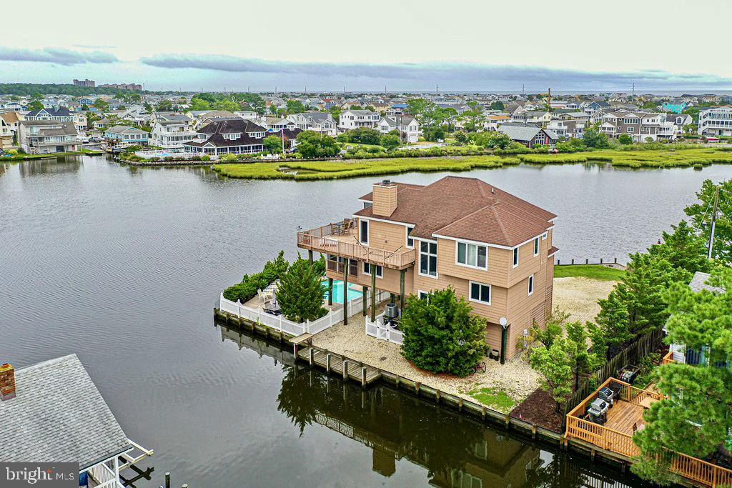 WATERFRONT Sunrise and Sunsets in this rare Creekfront location with easy boat access to the Open Bay.  Paradise with private pool, in sought after private community of Bayview Park in Bethany Beach.  Surrounded by water on 3 sides of a quiet road. This house features 192 feet of water frontage, a large docking area for boats and easy access to the beautful Assawoman Bay via Jefferson Creek. Custom built by Zonko Builders to maximize the panoramic water views, Views of marsh, water, and wildlife in every room.  With 2 stories and an inverted floor plan, this house offers 2 separate living spaces. The top floor features an open floor plan, beautiful Pine vaulted ceilings, wood burning fireplace, expansive wrap around deck and screened in porch. Owners suite, living and kitchen located on main floor maximizing views. The first floor features 3 bedrooms, 2 full bathrooms, a living room and a large screened in porch. Outdoor living space is host to private in-ground pool with cool bay breezes.  The ground level has a large enclosed storage area, outdoor shower, under house parking and large drive way for parking up to 10+ vehicles. With abundant water views, ample outdoor/indoor living spaces, this house is perfect for entertaining.   Just a few minute walk/bike to award winning beaches.  Now Is Your Time To Invest In The Beach Lifesyle! (interior photos to follow)
