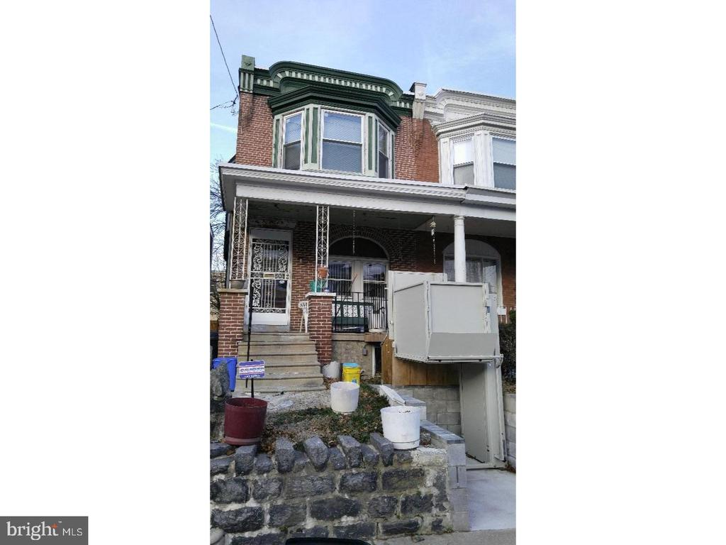 Huge twin, with newer kitchen, hardwood floors, some newer windows and 4 spacious bedrooms. This home is handicap equipped with an entry elevator and stair lift! Home does need some repair and upgrades. Being sold As-IS.