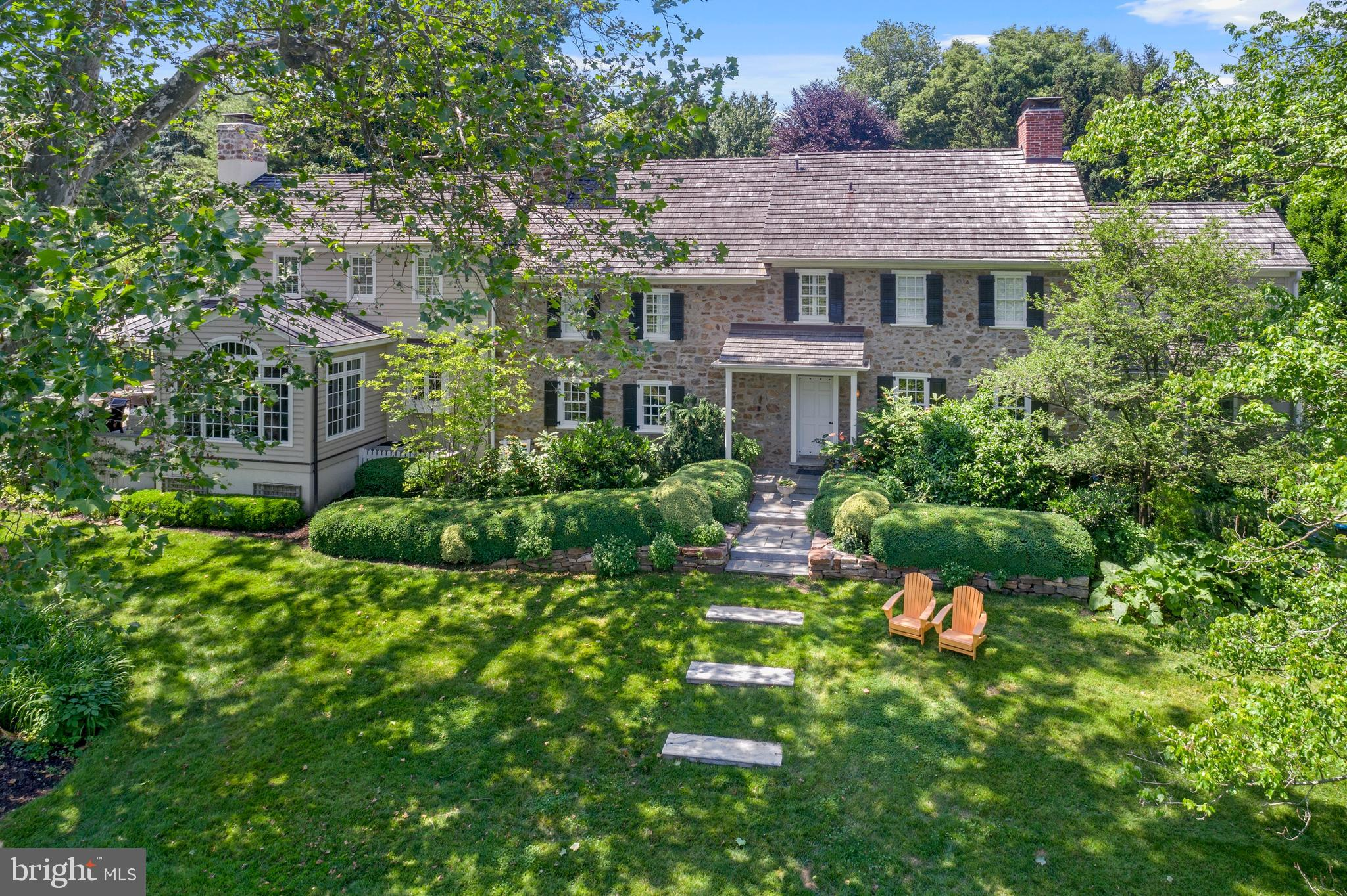 Don't miss this stunning property in the sought-after Brooke Farm neighborhood in Wayne. This restored and expanded 4-5 BD stone colonial offers a rare combination of historic charm combined with today's amenities, including an open concept Kitchen/Family Room and an attached, oversized, 3-car Garage. A unique feature is the fabulous Barn, which offers two levels of beautifully finished space with vaulted ceilings, exposed beams, a full bathroom, and wet bar/kitchenette. Currently used as a Media/Entertainment Room downstairs, and a Music Studio upstairs, this renovated historic structure has potential for use as an office, in-law / guest suite, art studio, or fitness studio… perfect for today's pandemic-influenced lifestyles. Nestled on a spectacular, beautifully landscaped 1.25+ acre property, this home is adjacent to acres of natural open space which offers supreme privacy. The sparkling pool and spa has an outdoor shower and adjacent covered patio off the barn. Originally renovated and expanded by Chip Vaughan, this home has timeless design that incorporates vintage architectural details including exposed stone walls, original fireplaces, gleaming wood floors, and extensive custom millwork. The modern floor plan includes a 1st floor Office, spacious Living Room, Dining Room with stunning original stone fireplace, and a gourmet Kitchen with open views of the large Family Room and Breakfast Room. You'll love relaxing and entertaining on multiple stone patios and gathering around the built-in firepit. Upstairs is a Master BD Suite with Master BA & walk-in closet, Laundry Room, (3) Hall BD, a large Bonus Room/5th BD and 2 more full BA. Downstairs is a finished Rec Room and a custom wine cellar. This home is centrally located in highly-ranked Radnor School District, just 5 minutes from train, shopping, and restaurants in the charming village of Wayne. Easy commuting distance to Center City, Airport, medical, and corporate centers. Showings by appt. only.