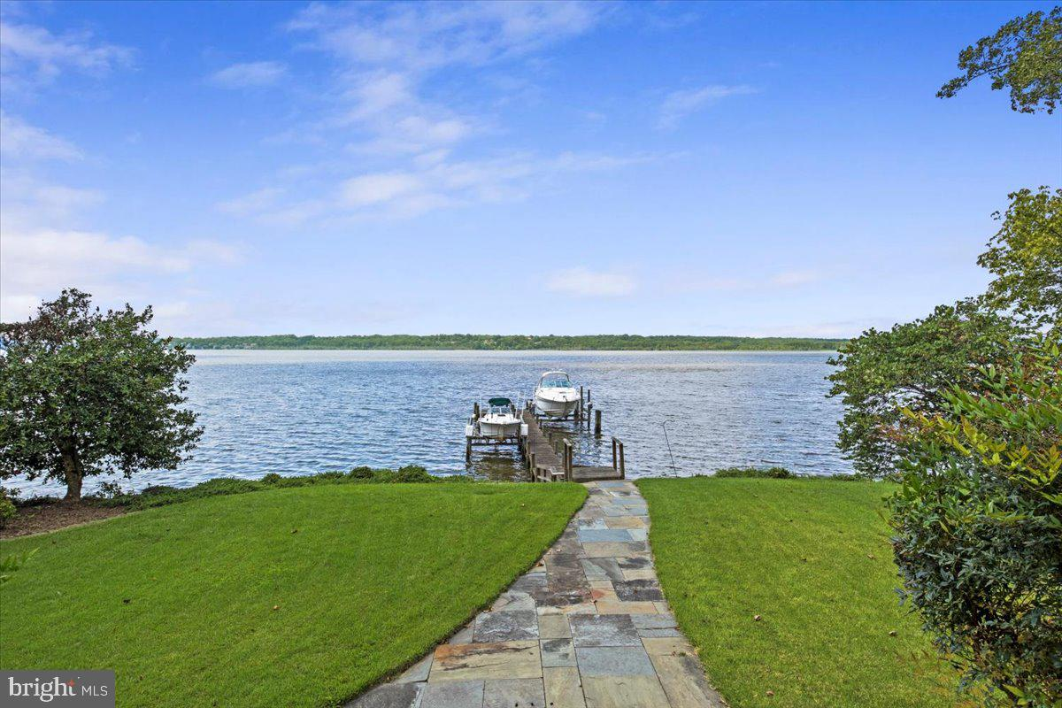There is waterfront and then there is THIS WATERFRONT! Direct Potomac River Waterfront like no other! Here you have fabulous views and your own private pier with 2 lifts so you can keep your watercraft right in your front yard. One lift supports 20,000 pounds and the other holds 8000 pounds. MLW is 5' at this location on the River.   Located at the end of a street, you have no homes on either side of you.  The owners suite is on the main level with Spectacular Views of the Potomac!   Renovated totally about 10 years ago, luxury can be found everywhere you go.  The owners bath has been upgraded to marble heated flooring and sumptuous appointments. There is a separate guest suite behind the owners suite with it's own private bath and kitchen and separate entrance. Perfect for weekend guests and family.  Upstairs are two other quite spacious bedrooms or offices with lots of built in storage space.  A full private bath is also on the upper level.   So well taken care of and fastidiously upgraded, you will feel as if you are in a luxury vacation suite.  But you are actually 15 minutes by boat to downtown DC and 20 minutes by car to all the sights and  restaurants of the District.  National Harbor is just 5 minutes away.   Outside you can use the outdoor fireplace and grill and sit by the waters edge on the slate patio. There is really no need to entertain anywhere else.    This is truly a wonderful find for a second home or year round living.   A true TIMLESS COLLECTION HOME!