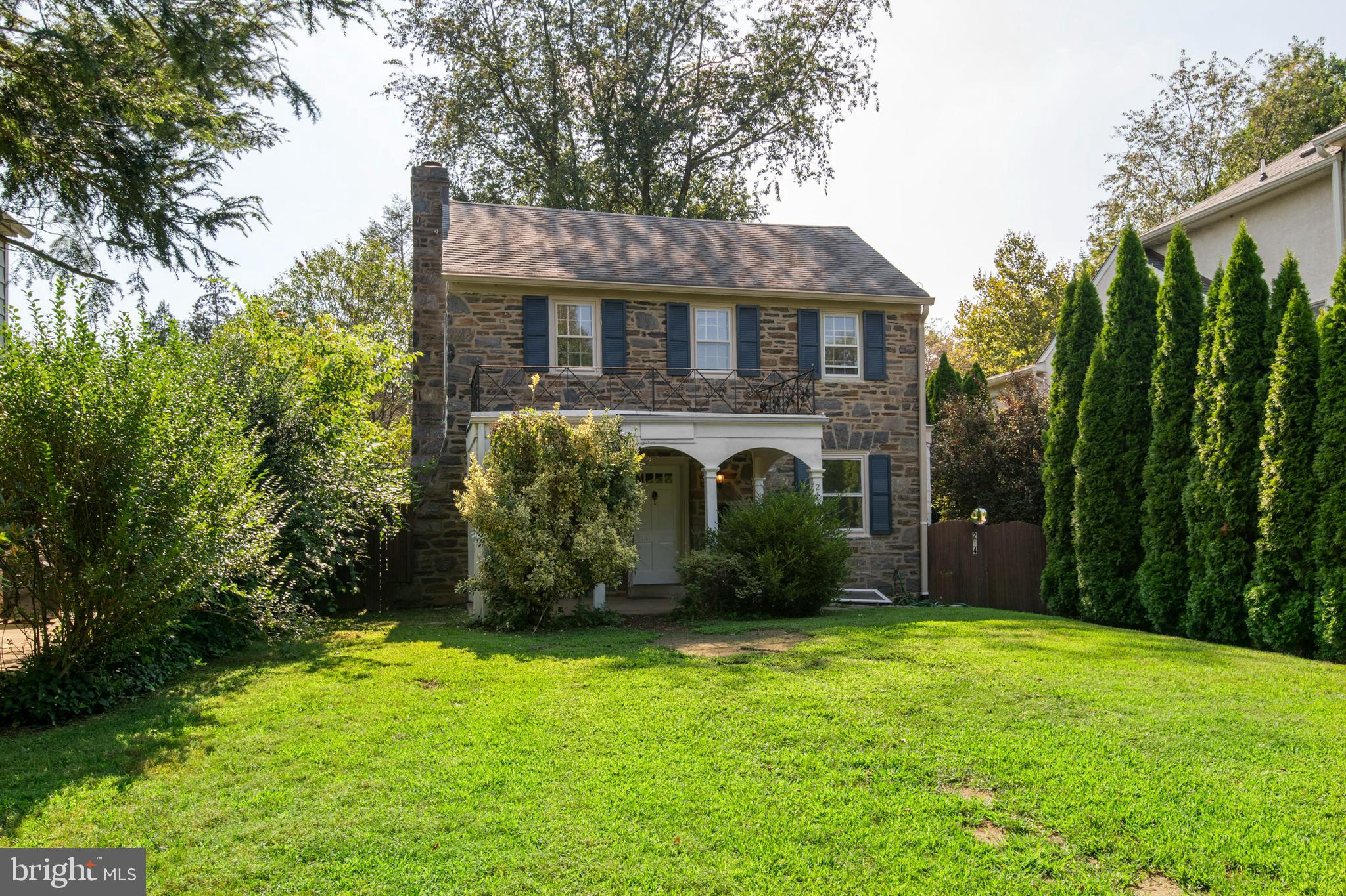 Welcome to this classic stone front, center hall colonial, set far back from the street with a large welcoming front porch just perfect for outdoor entertaining! . A charming covered porch, overlooking the large front lawn, is perfect for relaxing in privacy. Enter into the living room with gleaming hardwood floors, where you could cozy up in front of the fireplace or have fun game nights with friends. The formal dining room with hardwood floors is perfect for your holiday meals. The eat-in Kitchen was recently renovated with ample cabinets for storage, lots of granite counter space, and sliding glass doors to the outdoor deck, perfect for grilling and summer entertainment. The primary suite has three closets and a renovated bath. Three additional bedrooms and an updated hall bath complete the second floor. In addition, the fully finished basement is a perfect bonus space for a family room or office, and laundry facilities plus additional storage space. Conveniently located, walk-to location; restaurants, train, shopping, and the Cynwyd Biking and Walking Trail. Close to major highways and only 20 minutes from Center City. Now is your chance to make this house your next home! Get your best Present ever! Don't let this slip by.  Move right in and unpack your bags!!