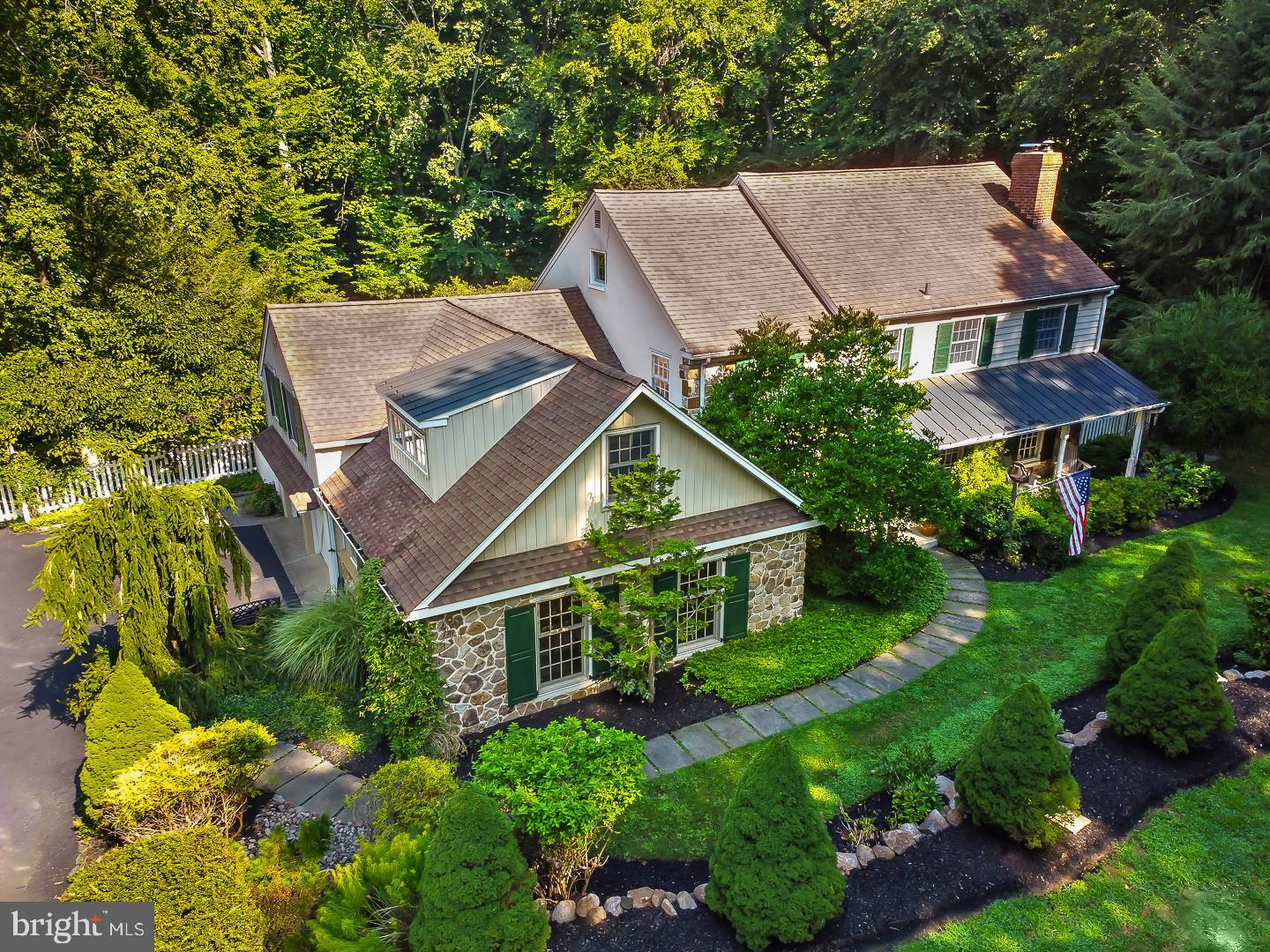 """Stunning 5 bedroom, 2.3 bath custom Colonial in desirable Echo Valley! Imagine owning this private and serene oasis which incorporates each element of outdoor living with exquisite planning and foresight! Whether you are drawn in by  the pool, the lush  gardens, or the backdrop of the mature trees with views of the two waterfalls and koi pond, your """"great escape"""" is as far as your back door!  Stroll over two bridges  while enjoying the woods and  walking trail. The key to this tranquil setting is that it is manageable, modernized and lovingly maintained. A spacious  floor plan greets you from the moment you walk into the foyer adjoined by the lovely living room to the right and a sizable formal dining room to your left. Adjacent to the dining room is a huge entertaining room which includes the pool table and built- in surround sound. The heart of the home is the kitchen and dramatic great room and wonderful bright sunroom! The kitchen is perfect for the seasoned chef with abundant cabinets, center island, ample  counter space and storage. Ideal for large or small gatherings, this space transitions seamlessly  to the custom eating area and two story Great Room with a wrap around deck. The great room is accentuated by exposed wood beams, brick floors, wood burning fireplace and is  bathed in natural light from the abundant windows and French doors that lead to the deck. Enjoy the spectacular view of the amazing backyard. The main level is completed by the hall bath, large laundry room and wet bar which has pretty counter tops and glass overhead cabinets . The second floor has 4 spacious bedrooms. The main bedroom has a full bath and walk-in closet. The other 3 bedrooms share a hall bath. There is a walk-up floored attic and whole house generator. Don't miss the separate wing upstairs from the kitchen. This 5th bedroom and spacious living area and bath offers multiple opportunities for an au-pair suite, additional primary suite and the list goes on. Convenient heated a"""